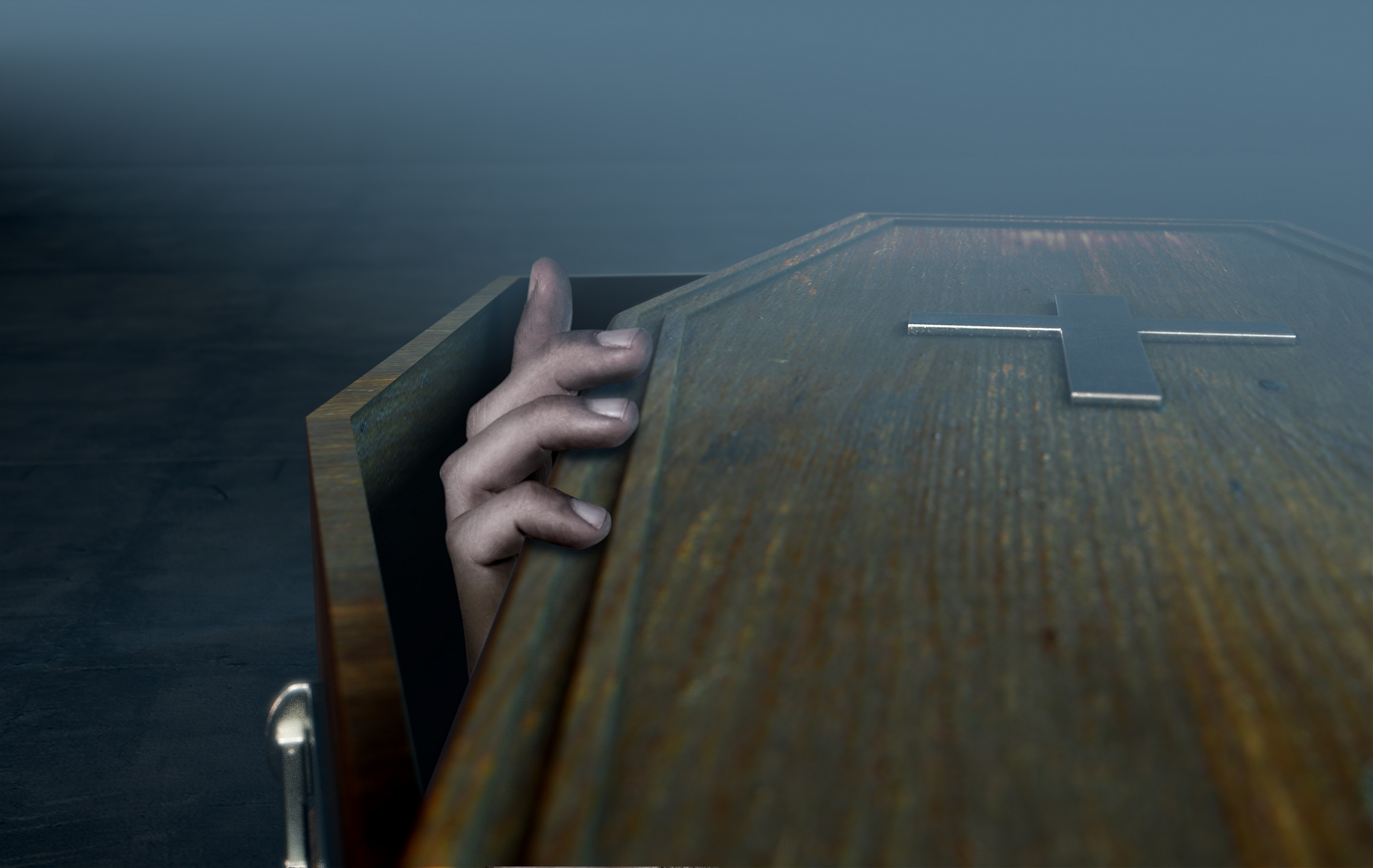 Hand Coming Out Of Coffin Foggy