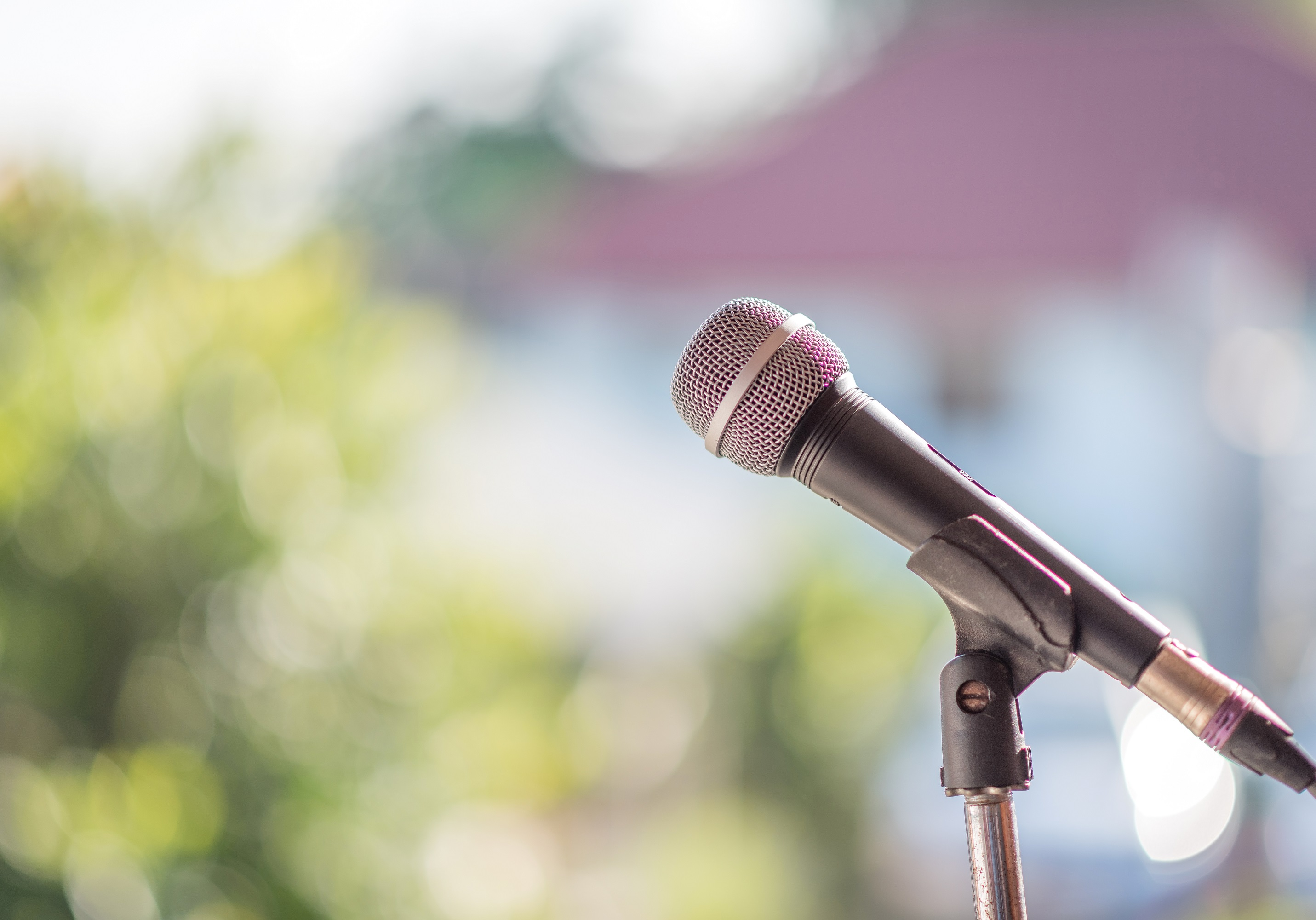 Microphone Closeup Blurred Outdoor Background