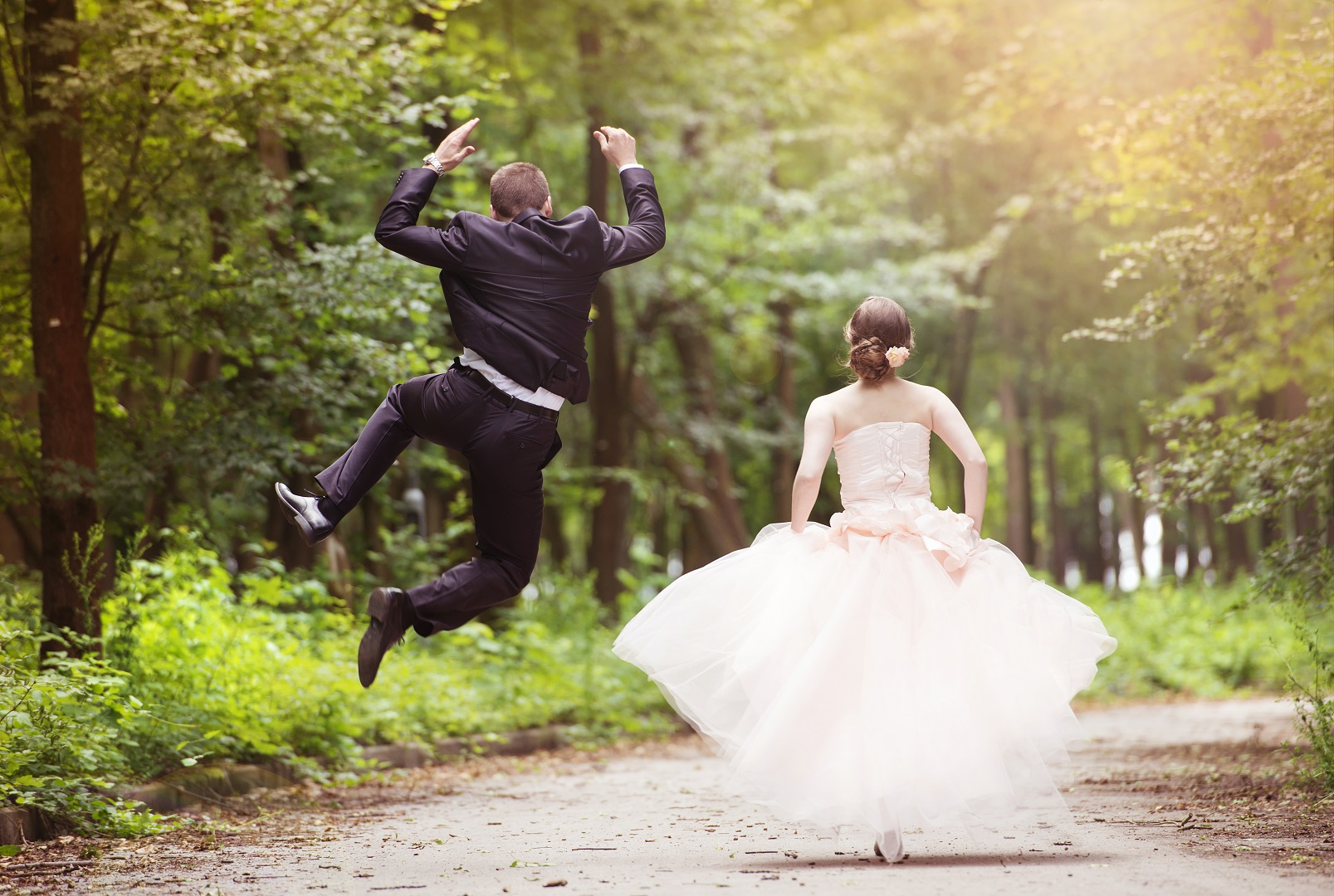 Bride and Groom Running Jumping for Joy
