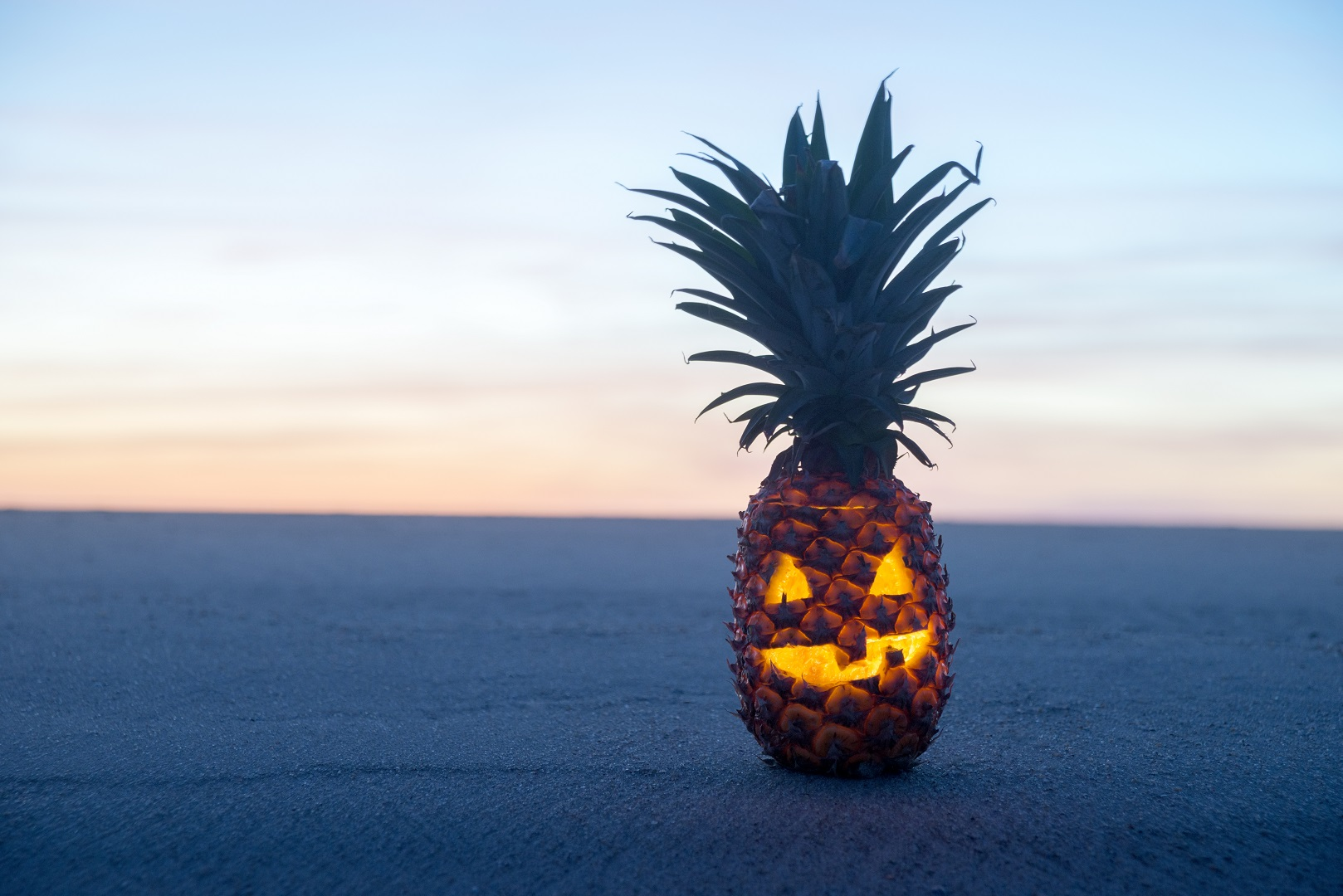 Pineapple Jack O Lantern Glowing on Beach