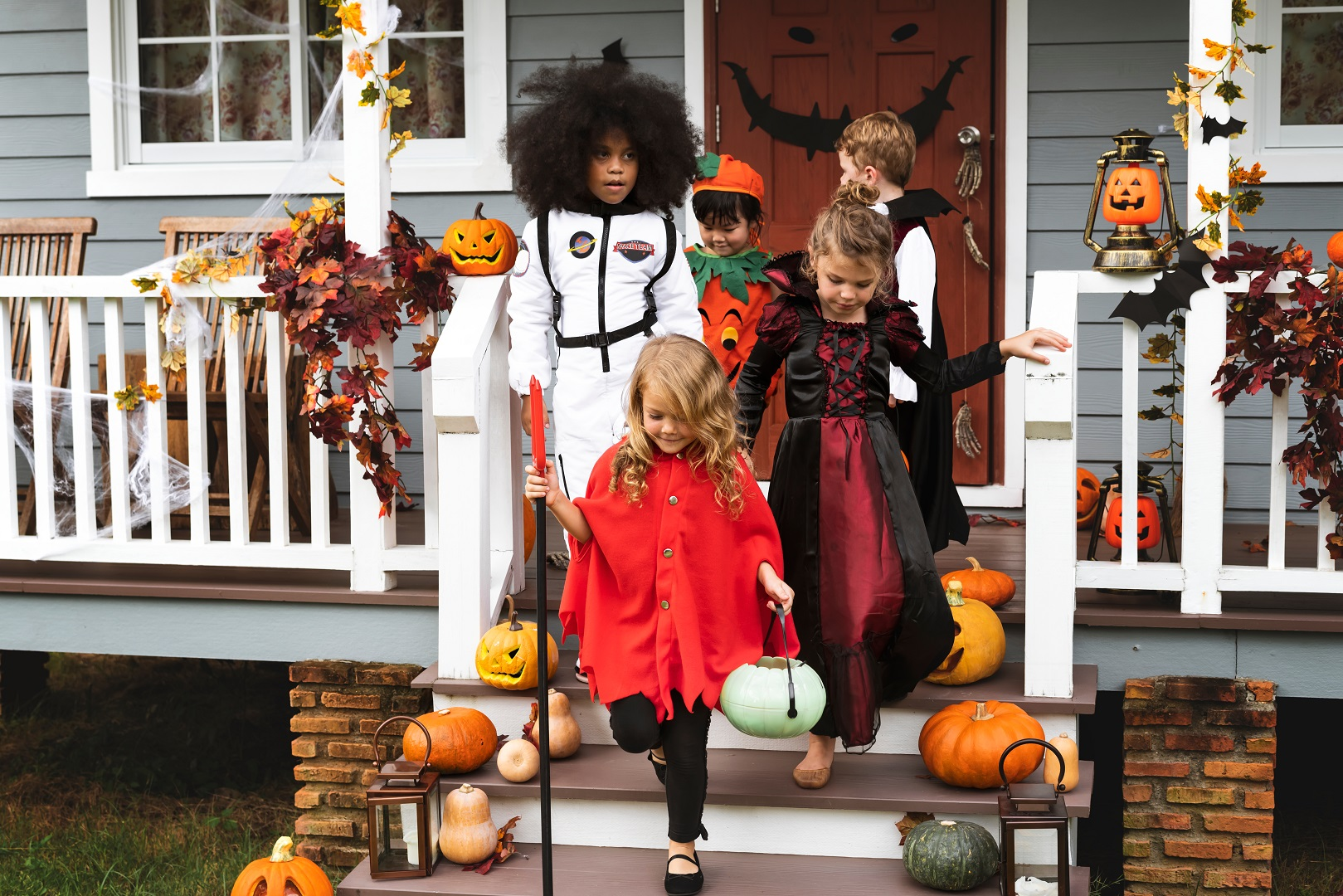 Children Trick or Treating Walking Off Porch