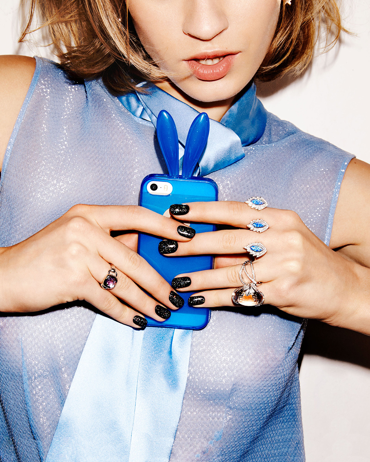 woman taking selfie with blue bunny ears phone case