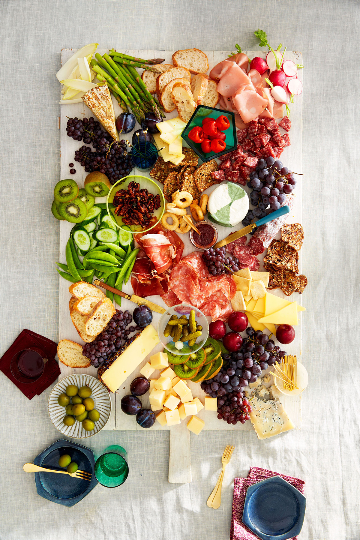 fruit cheese and vegetables on board appetizer spread