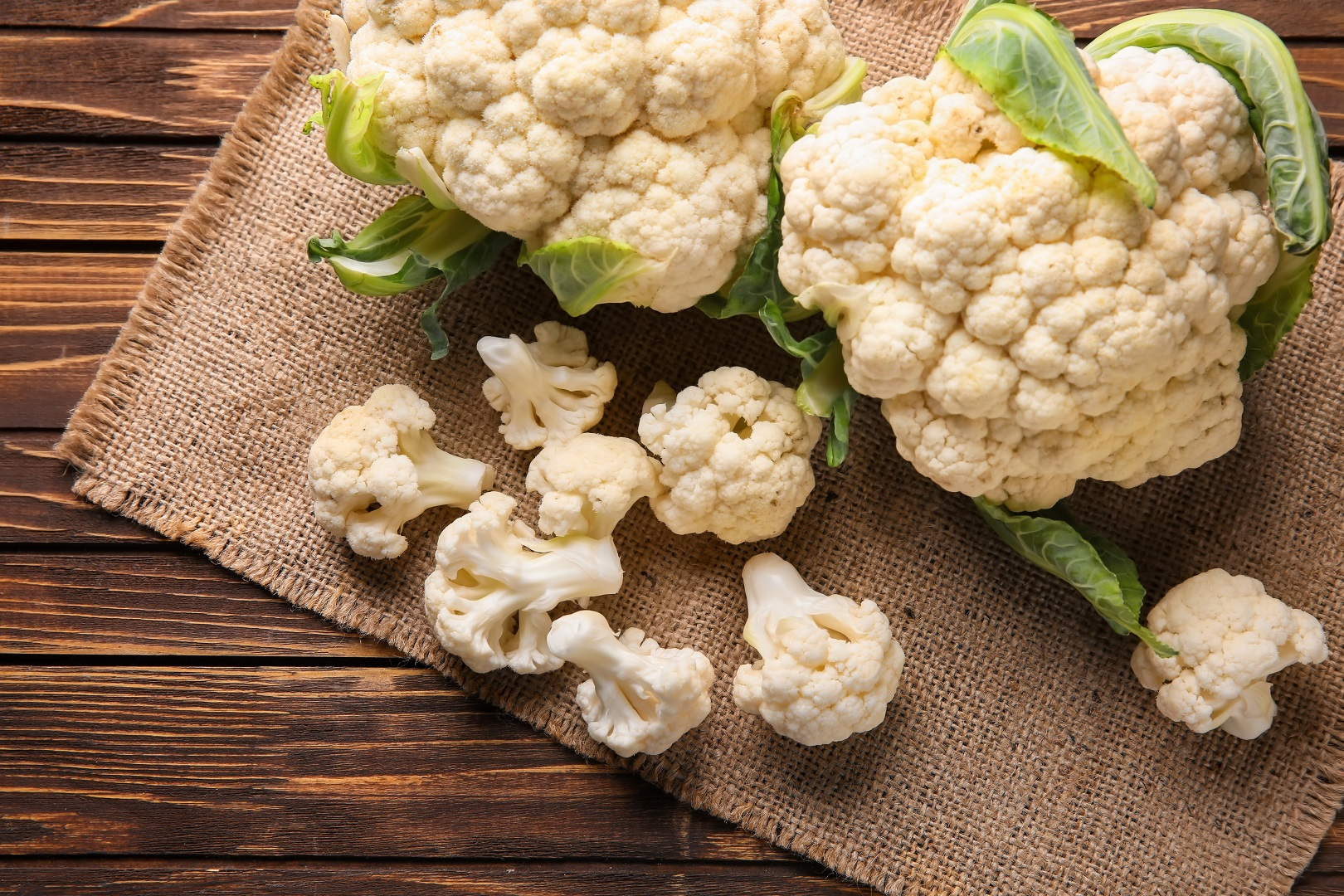 Fresh Cauliflower on Wooden Table and Burlap