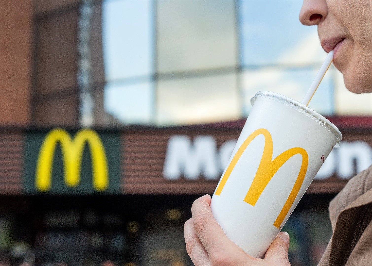 Woman Drinking From McDonalds Cup