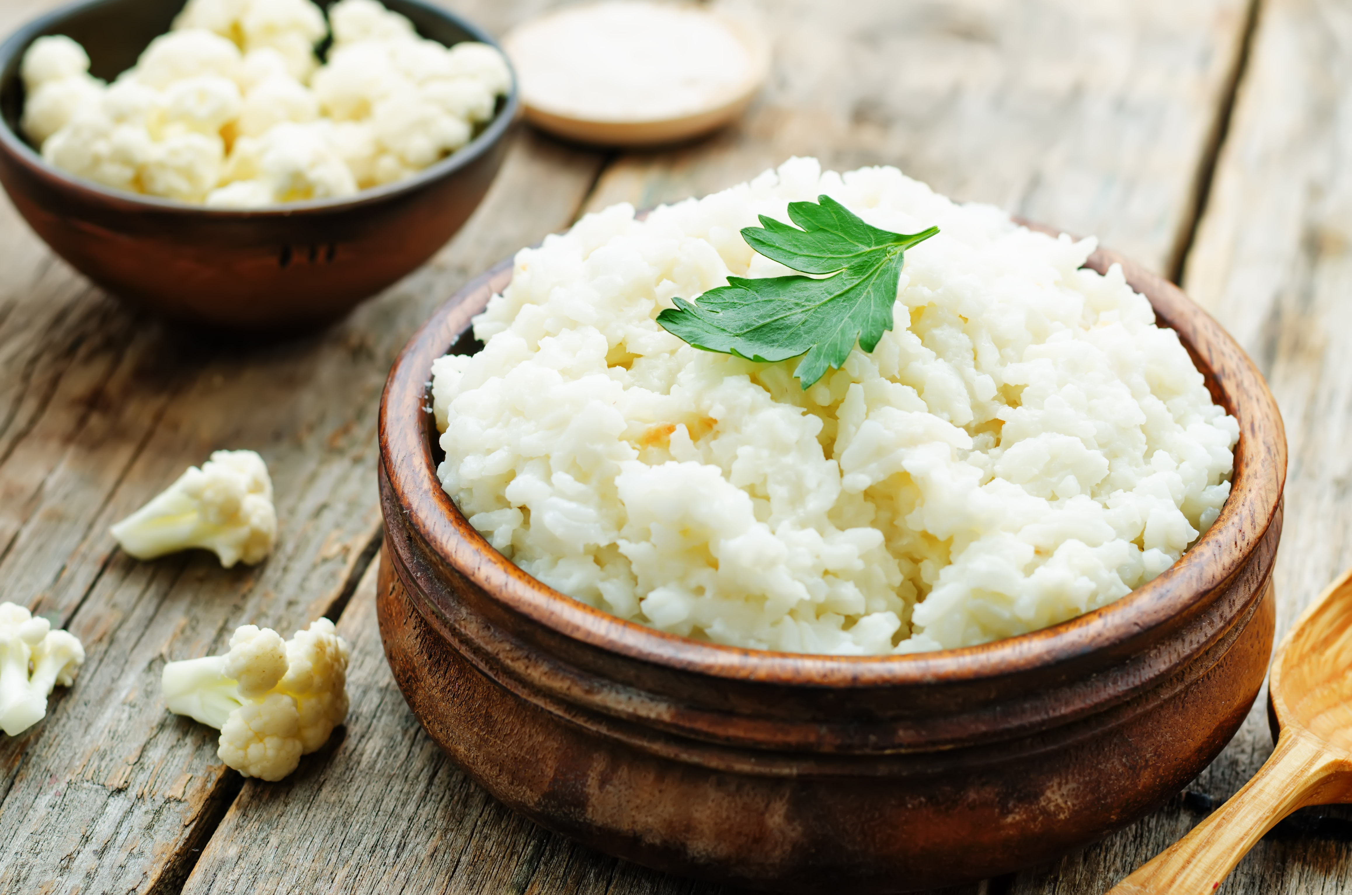 Cauliflower Rice in Wooden Bowl on Table