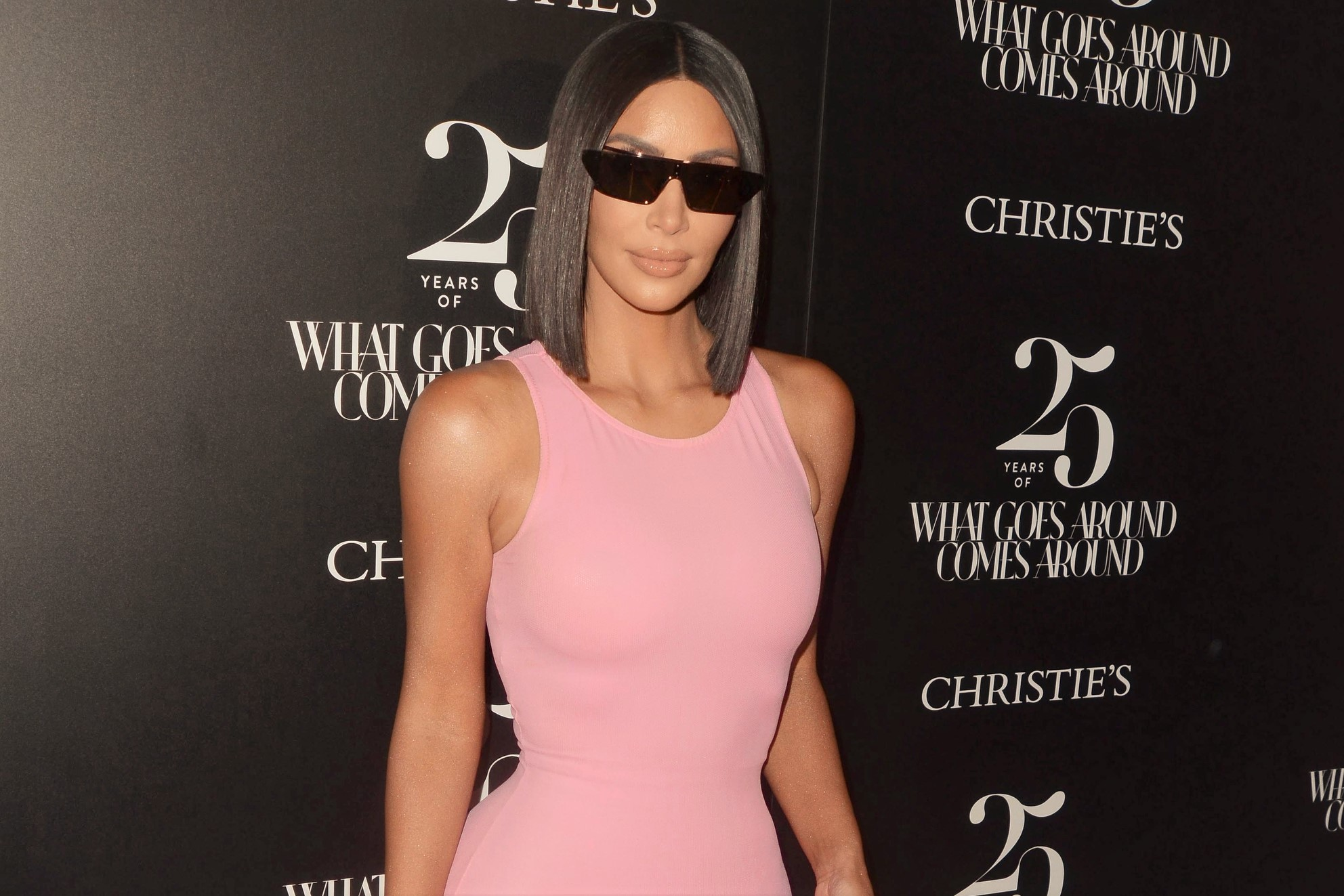 Kim Kardashian Neon Pink Dress and Sunglasses
