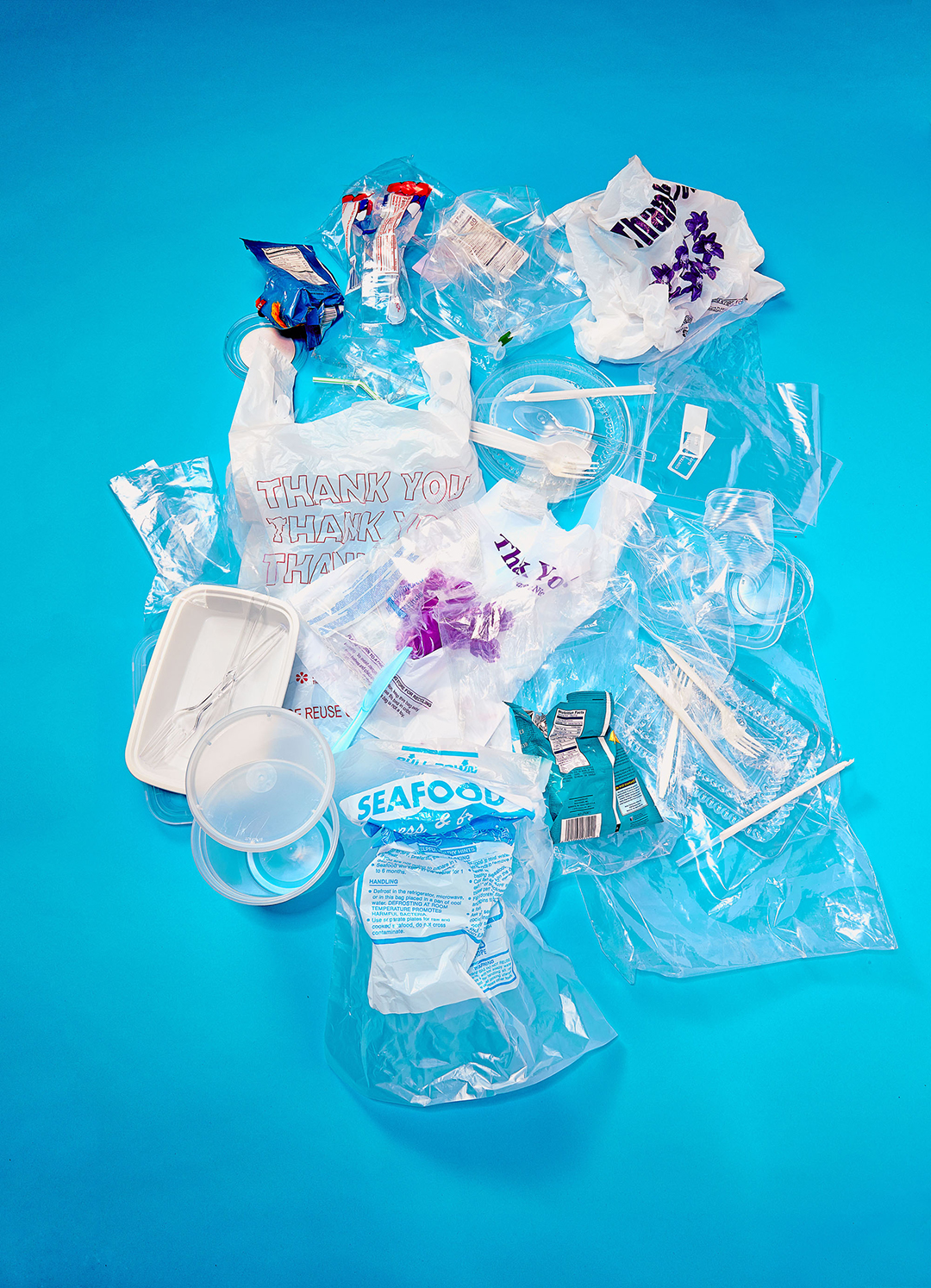 plastic bag waste on bright blue background
