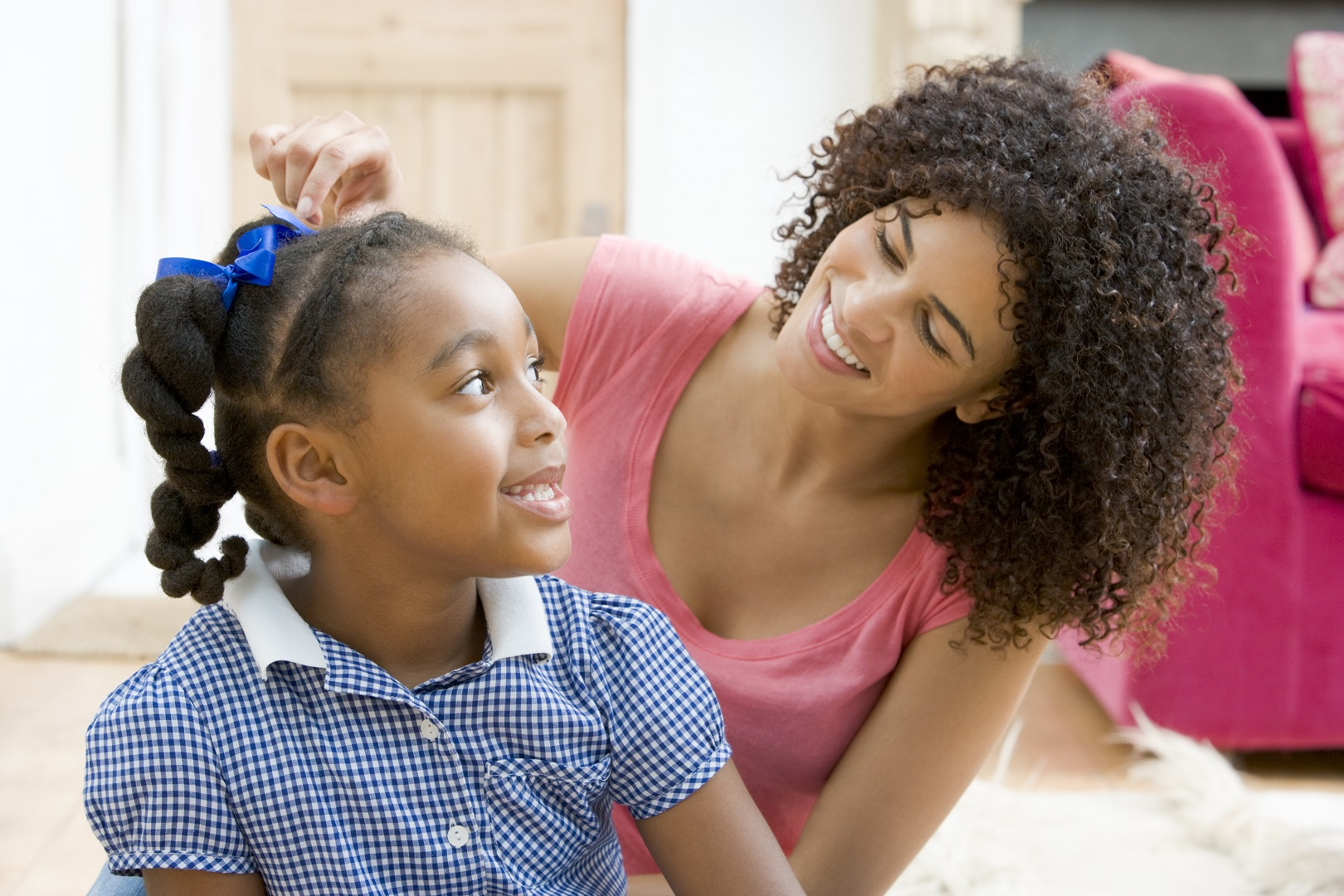 Black Mother Fixing Daughters Hair