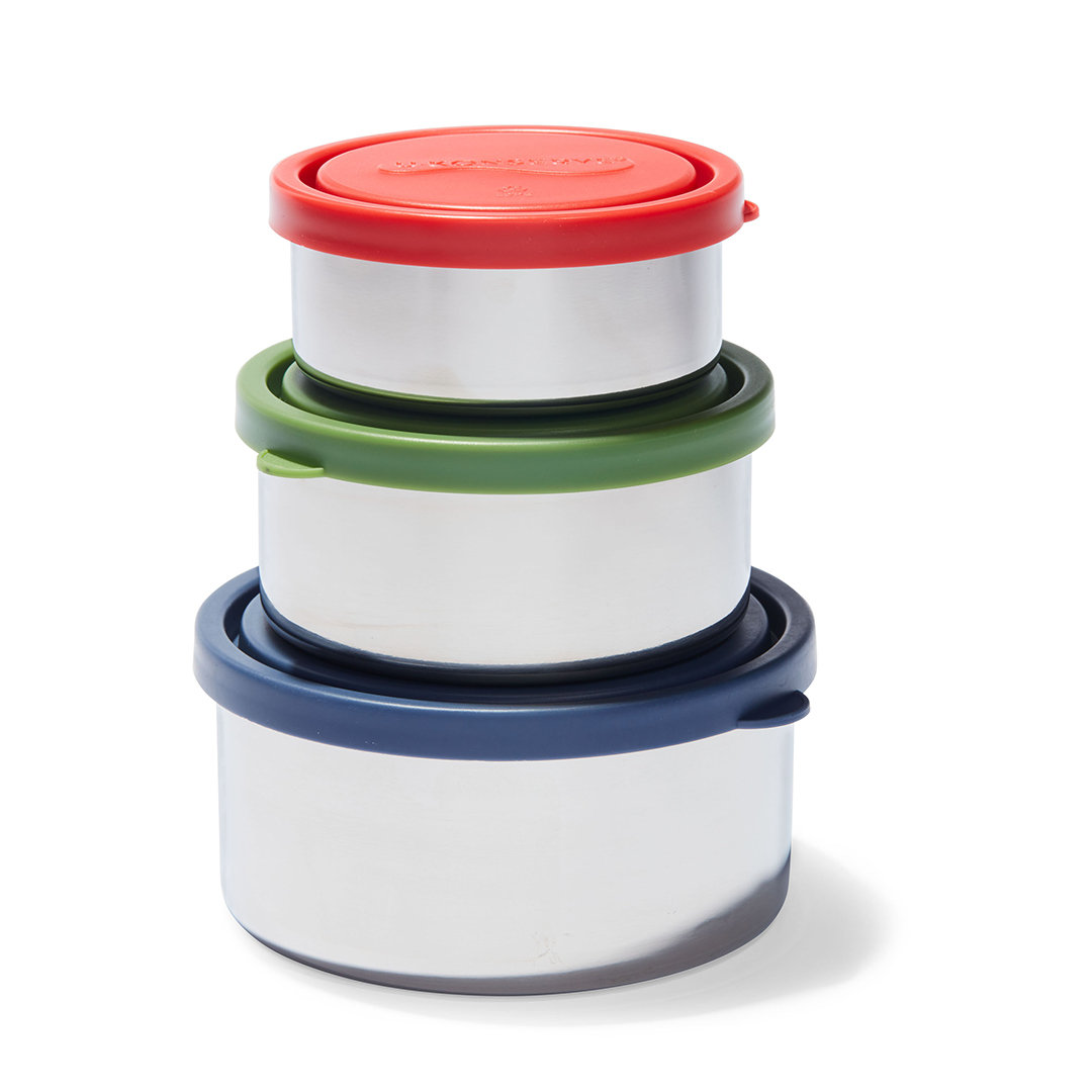 stainless steel containers in a stack with red, green, and navy lids