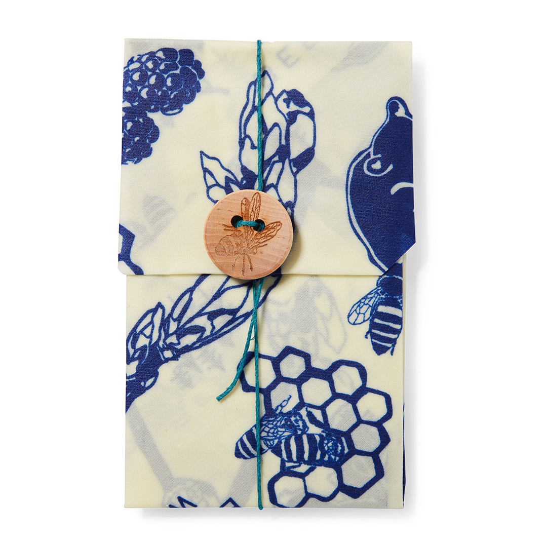 bees wrap sandwich bag with blue pattern and brown button