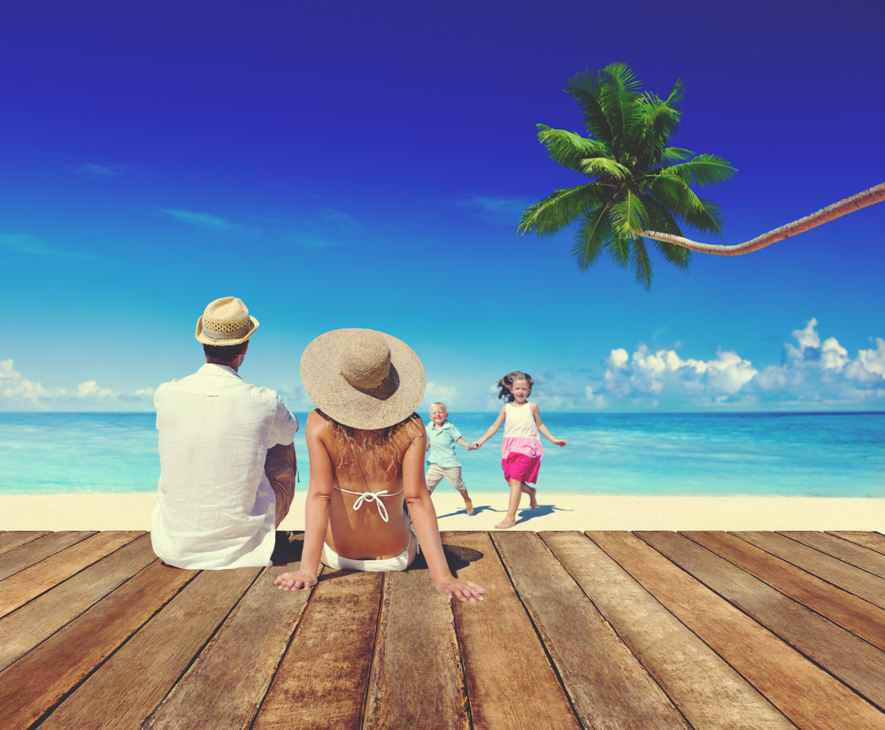 Mom Dad Daughter and Son on Beach next to Palm Tree