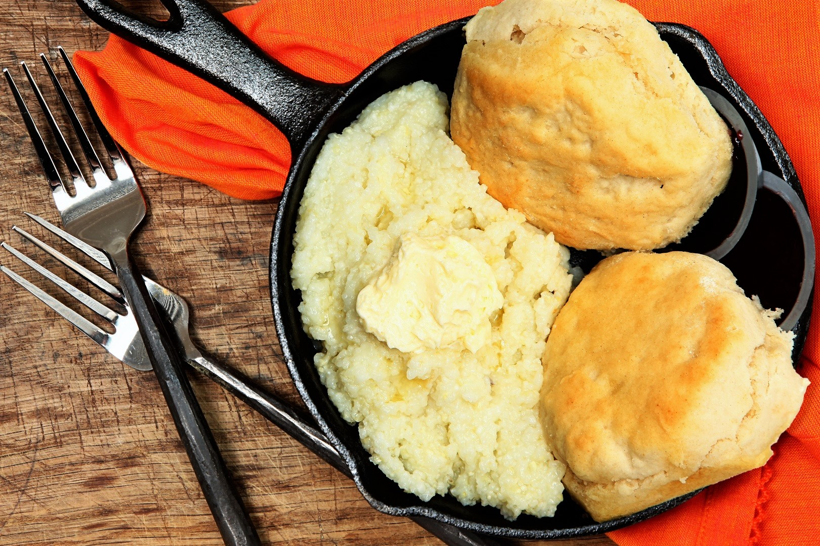 Grits and Biscuits on Iron Skillet with Metal Fork