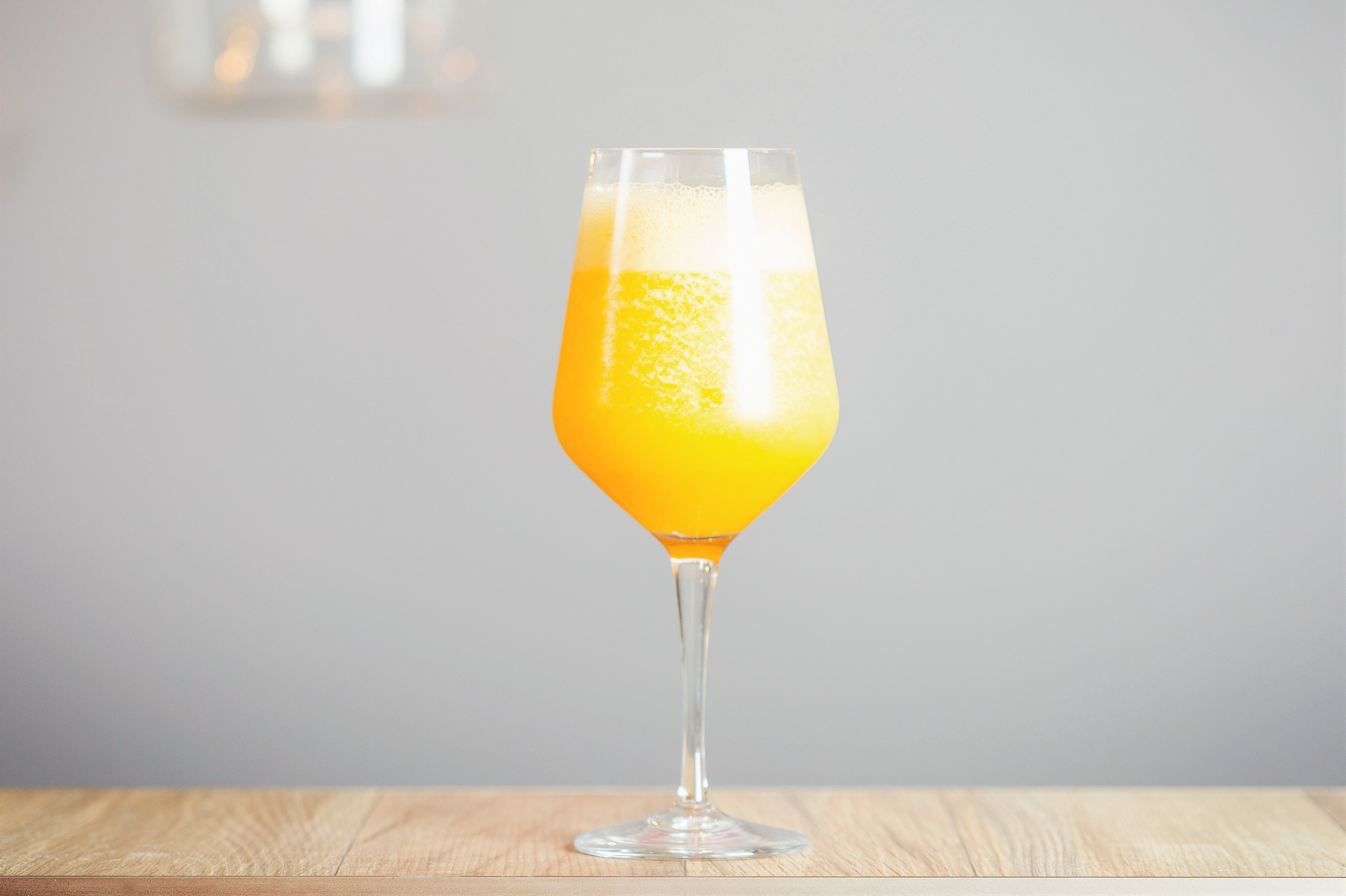 Ice Cold Mimosa in Wine Glass