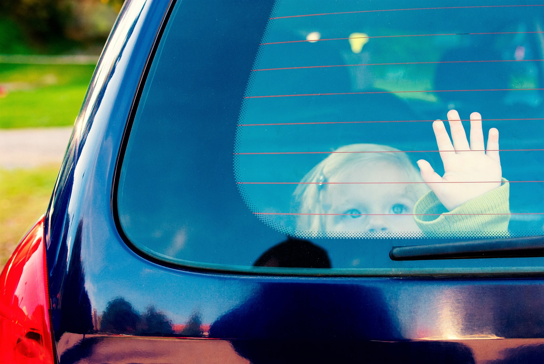 Little Girl in Car Alone Hand on Window