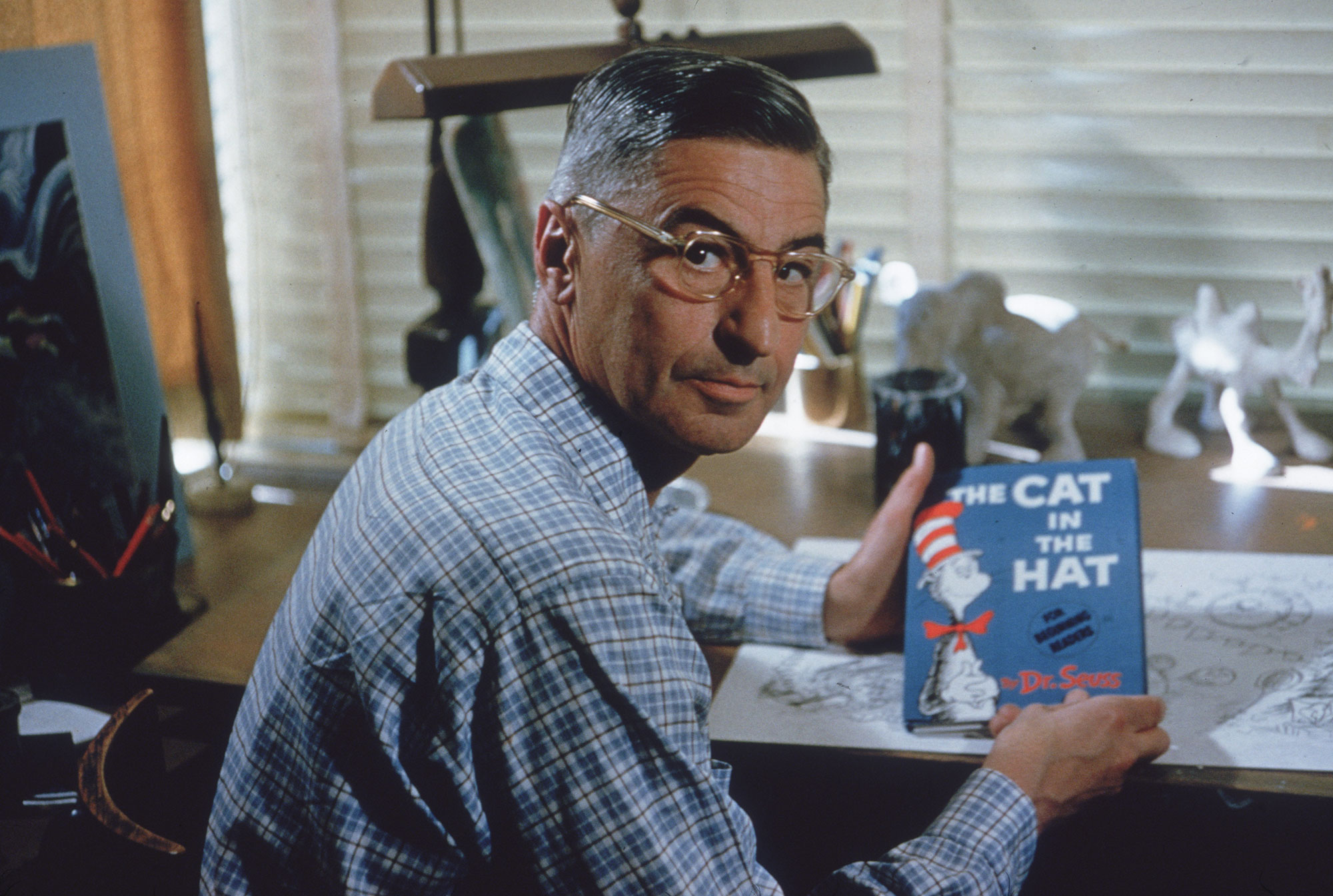 Dr Seuss Author Holding Cat In The Hat Book
