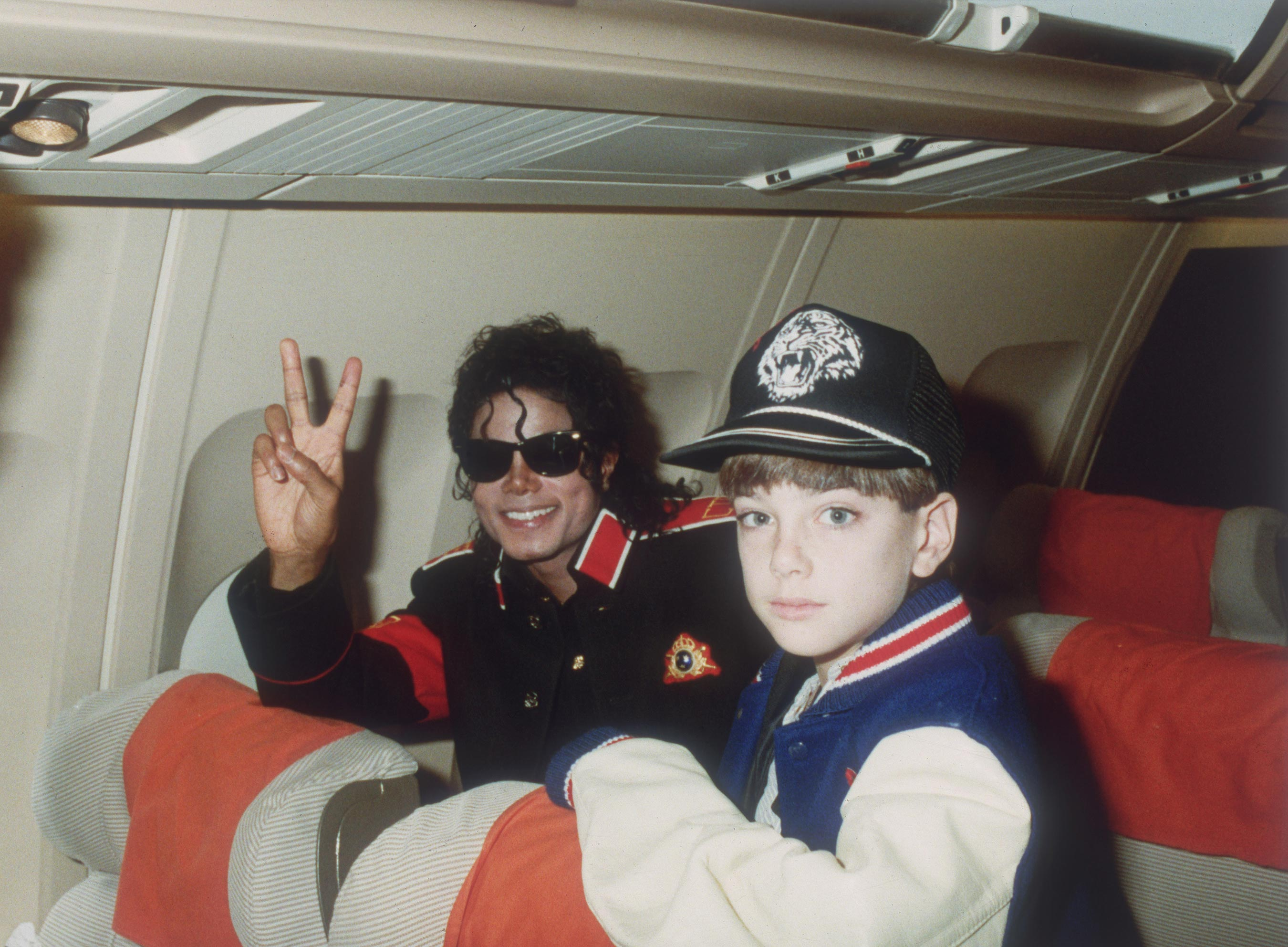 Michael Jackson with 10 year old Jimmy Safechuck on the tour plane on 11th of July 1988.