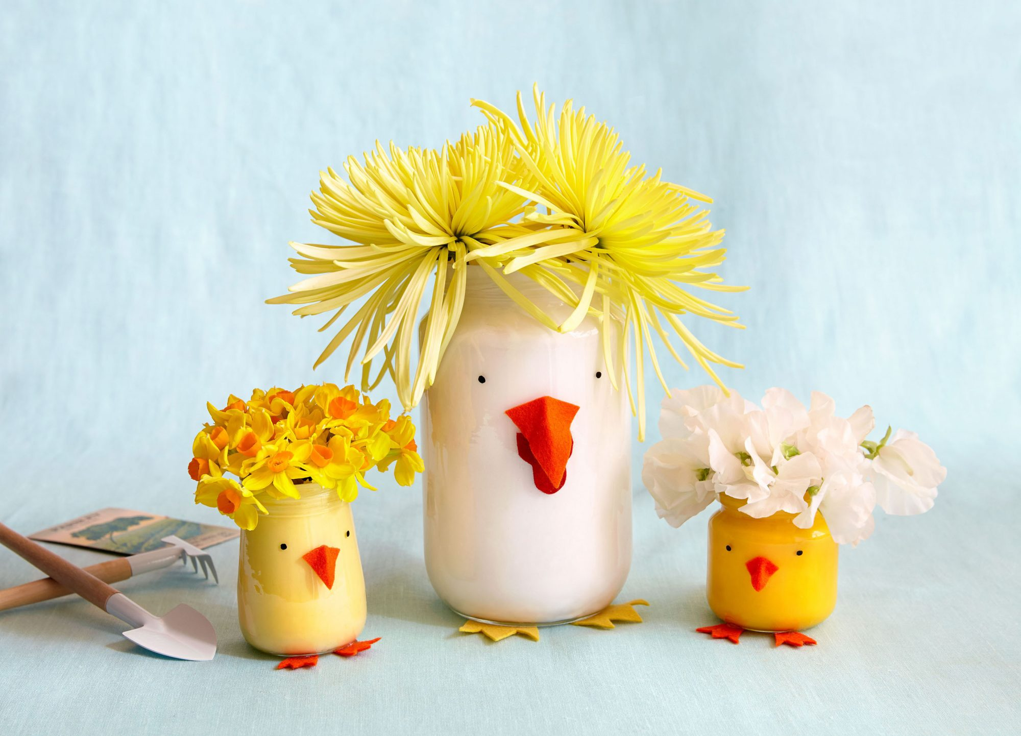 large white chicken little jar and two small yellow chicken little jars