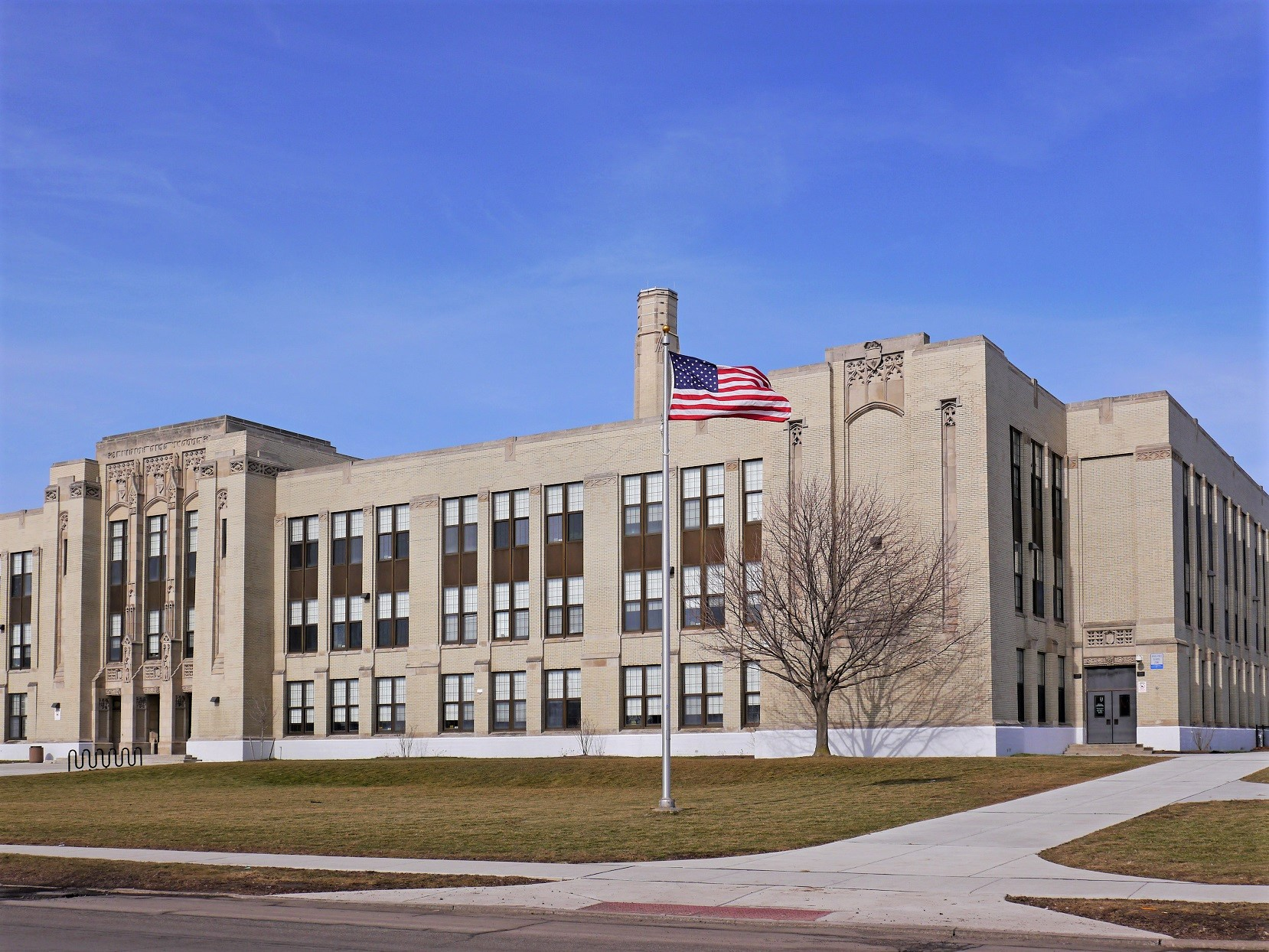 High School Building with American Flag Pole
