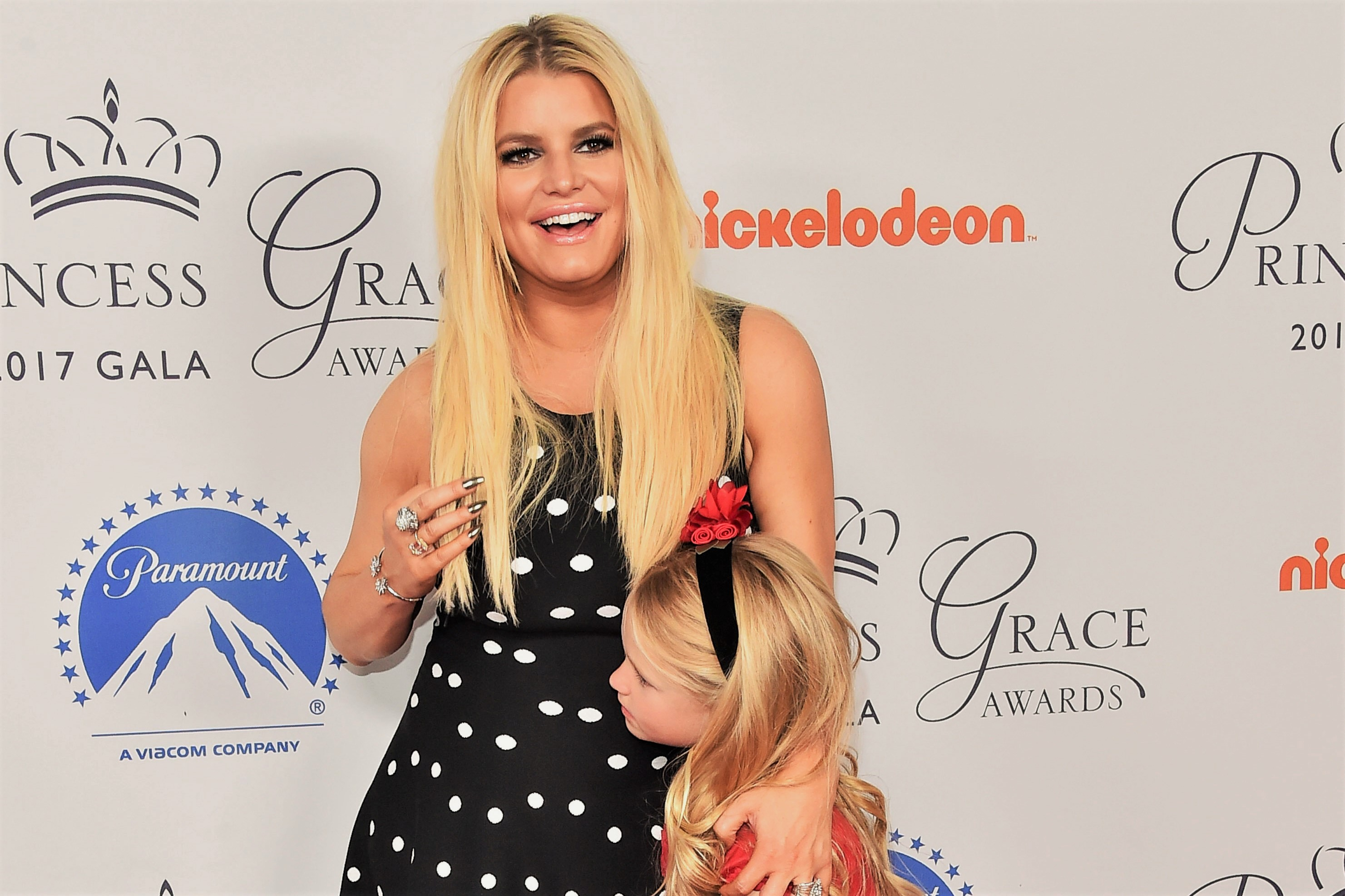 Jessica Simpson and Daughter Black White Polka Dot Dress and Red Bow