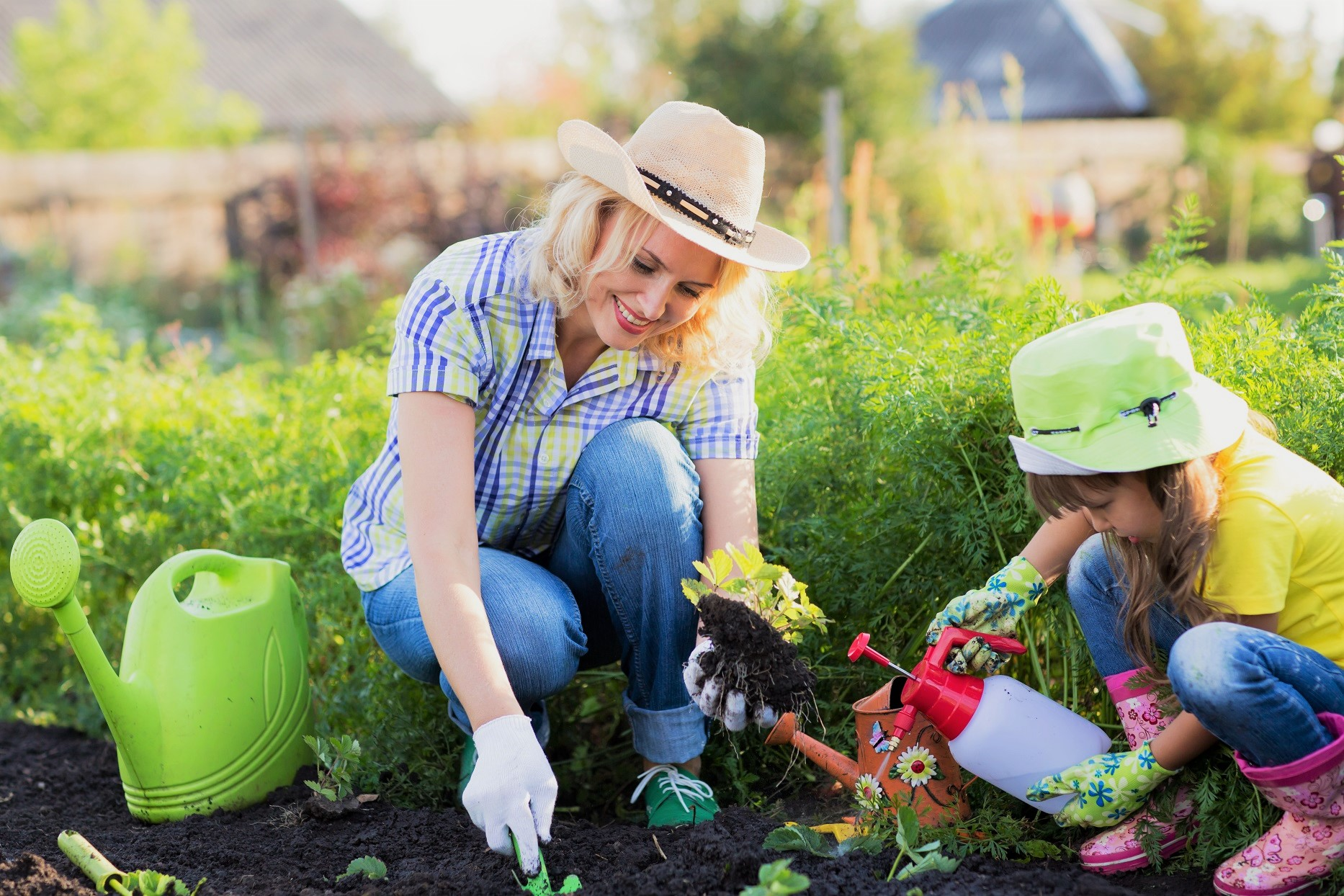 Mother and Daughter Gardening Dig Water Plants Sunny