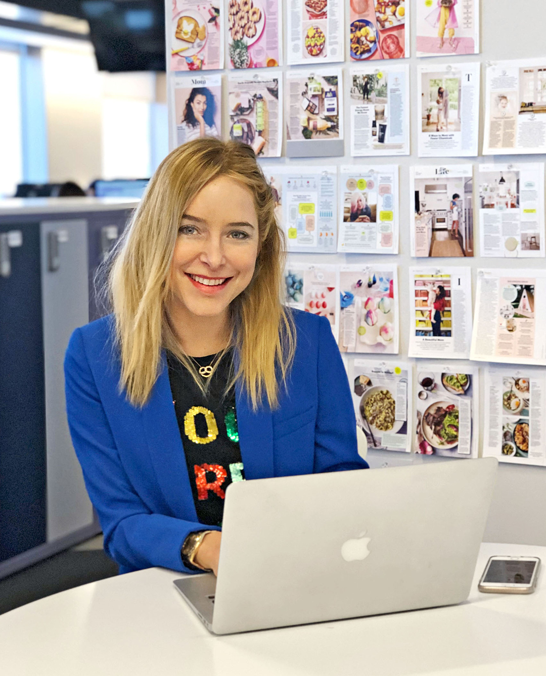 Jenny Mollen sitting at desk with laptop