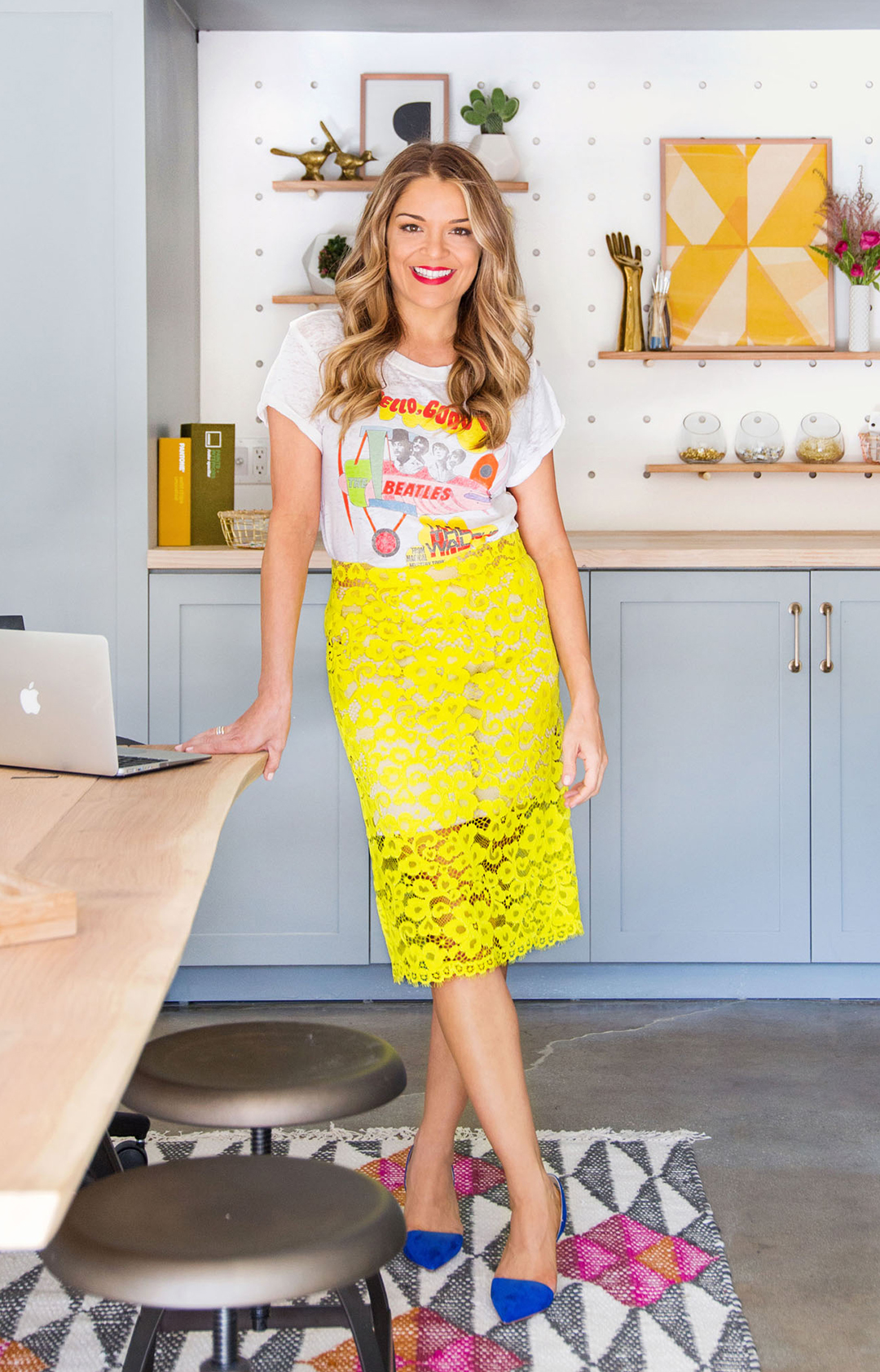 Sabrina Soto in kitchen wearing yellow skirt