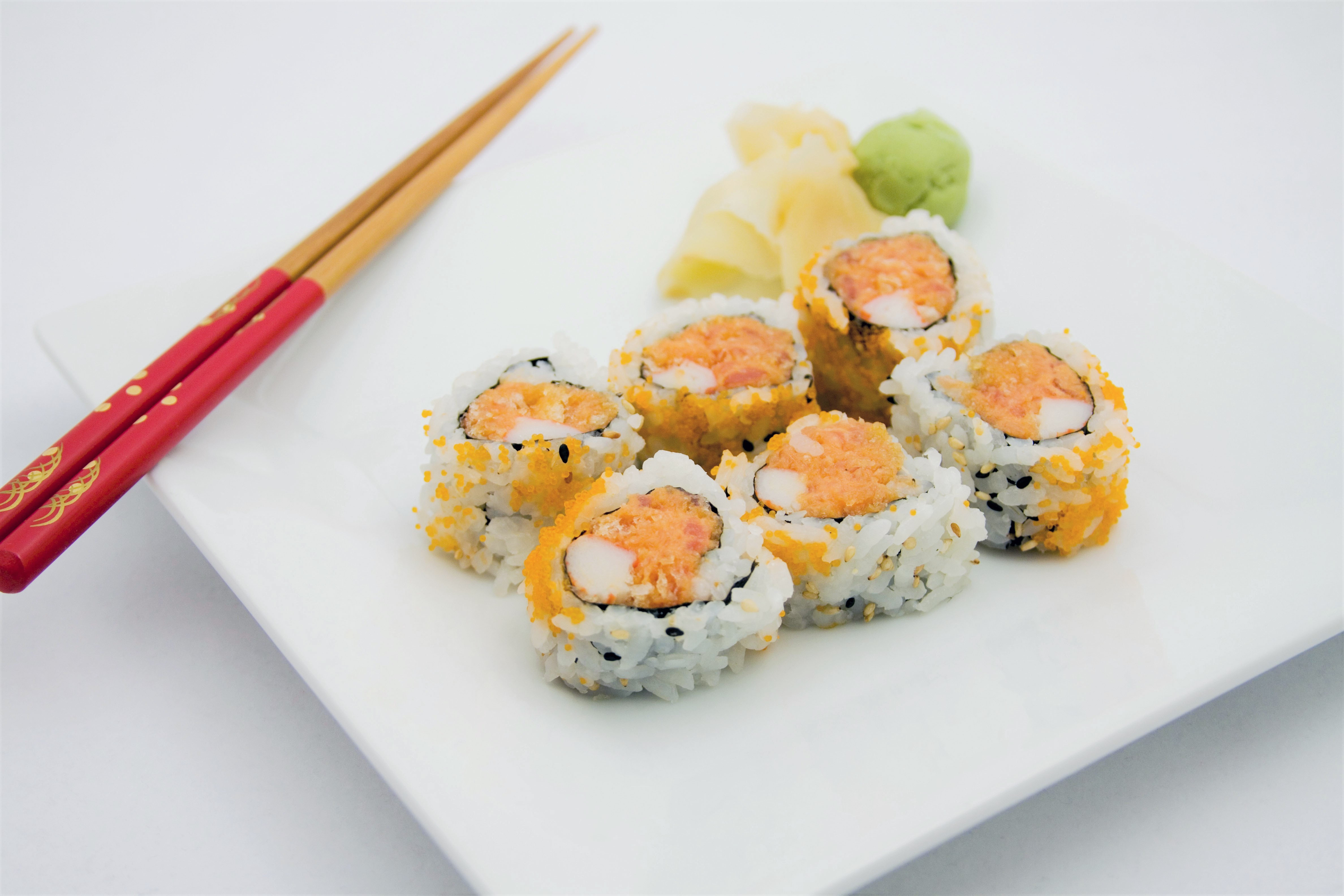 Spicy Tuna Rolls on Plate with Chopsticks Maki Roll