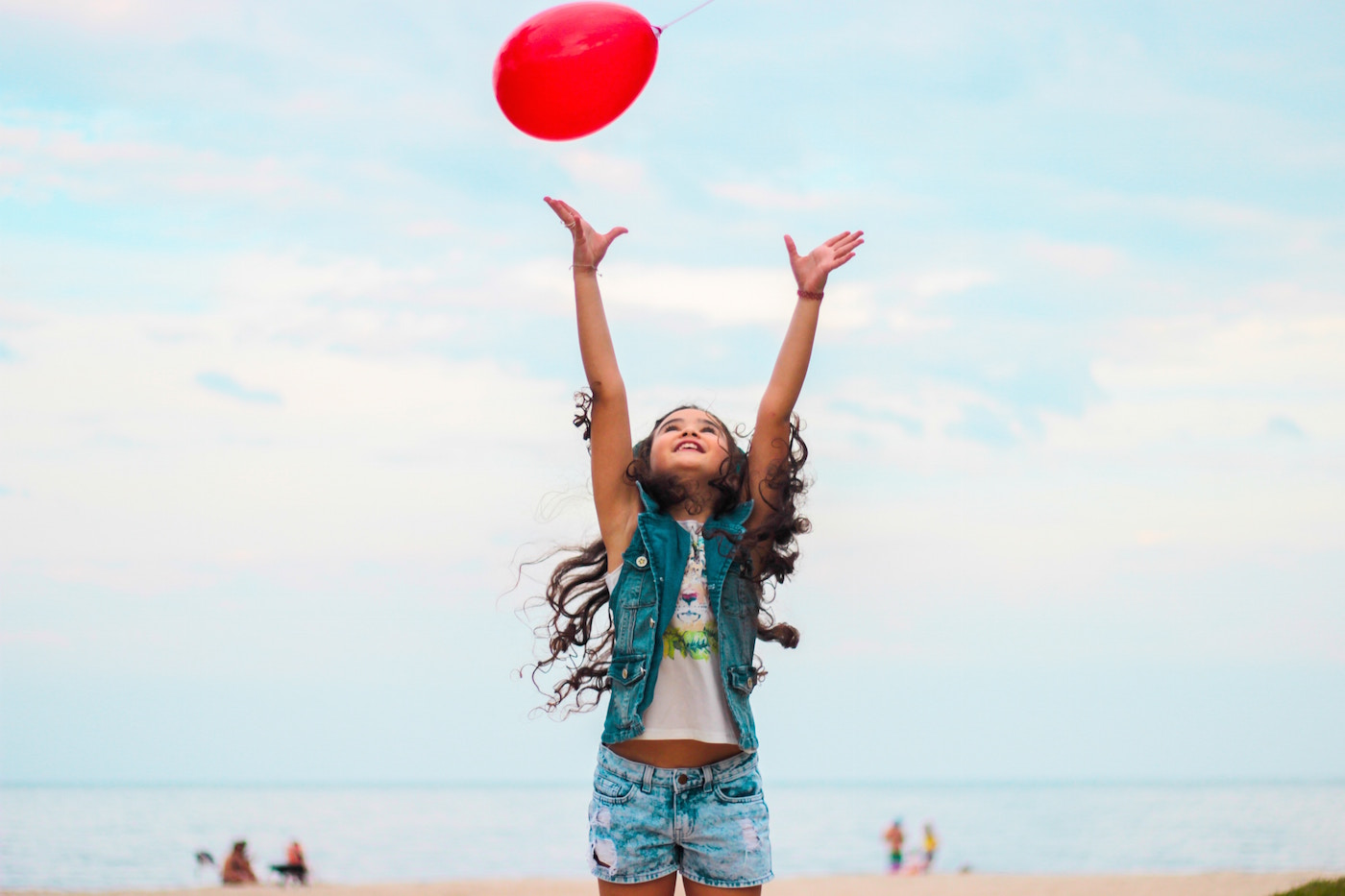 girl playing with balloon at the beach.jpg