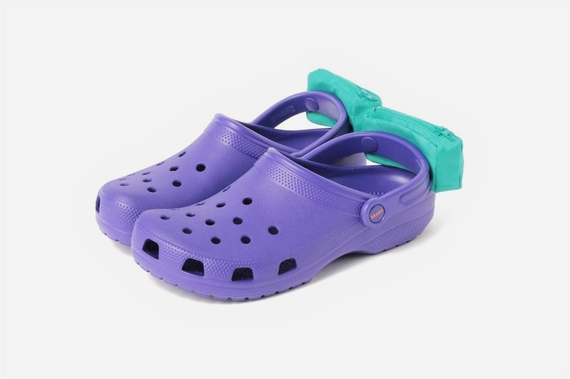 Purple Crocs With Fanny Packs on Feet