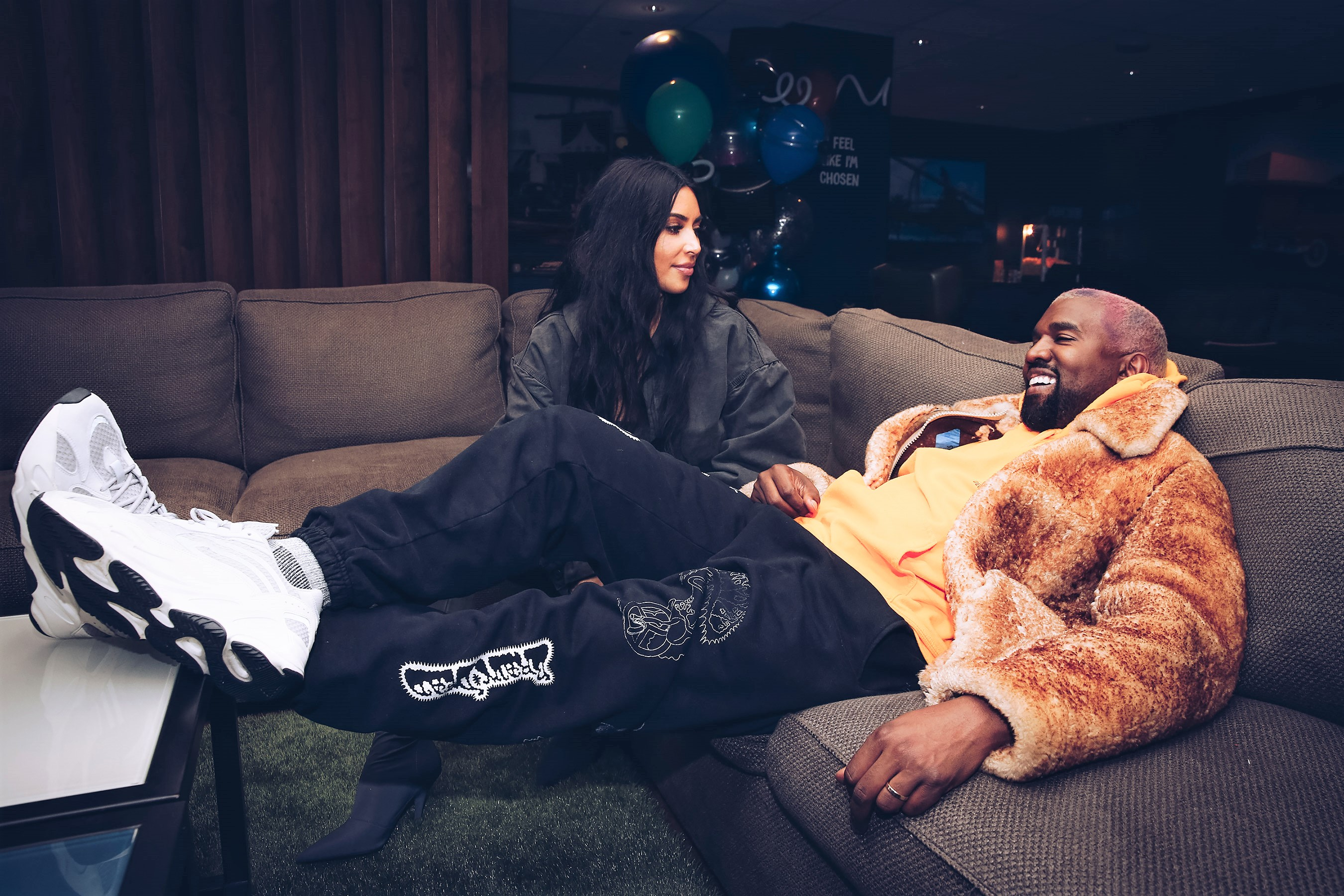Kim Kardashian West and Kanye West Sitting on Couch Laughing