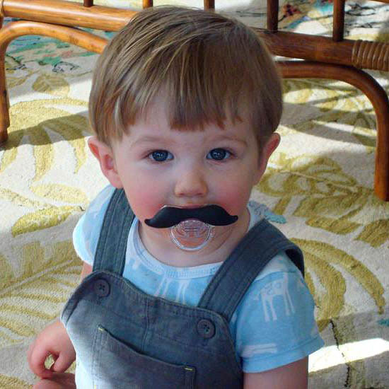 When a fake mustache is attached to a pacifier, people may start to believe it's real.
