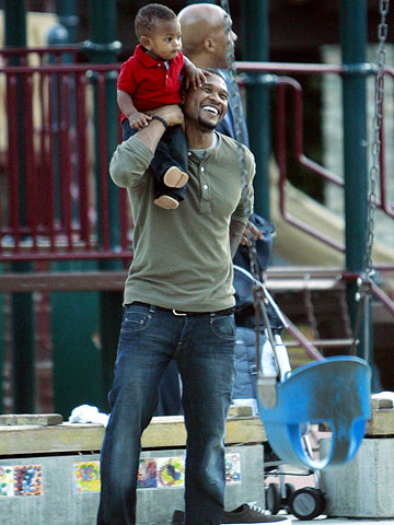 Usher with son in park