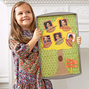 girl holding Family Tree leaf craft