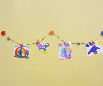 kids art haning on wall by