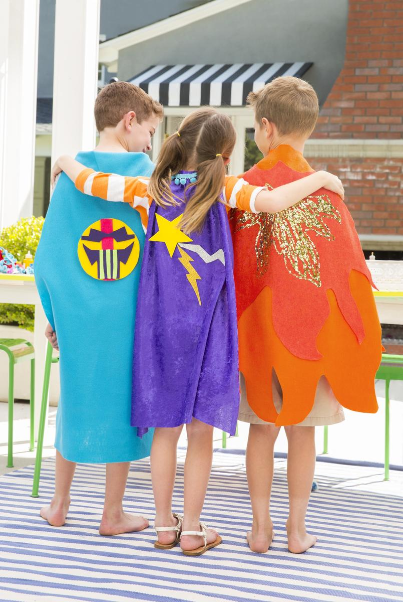 3 Kids Showing Off Their Superhero Capes
