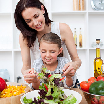 mother and child making salad