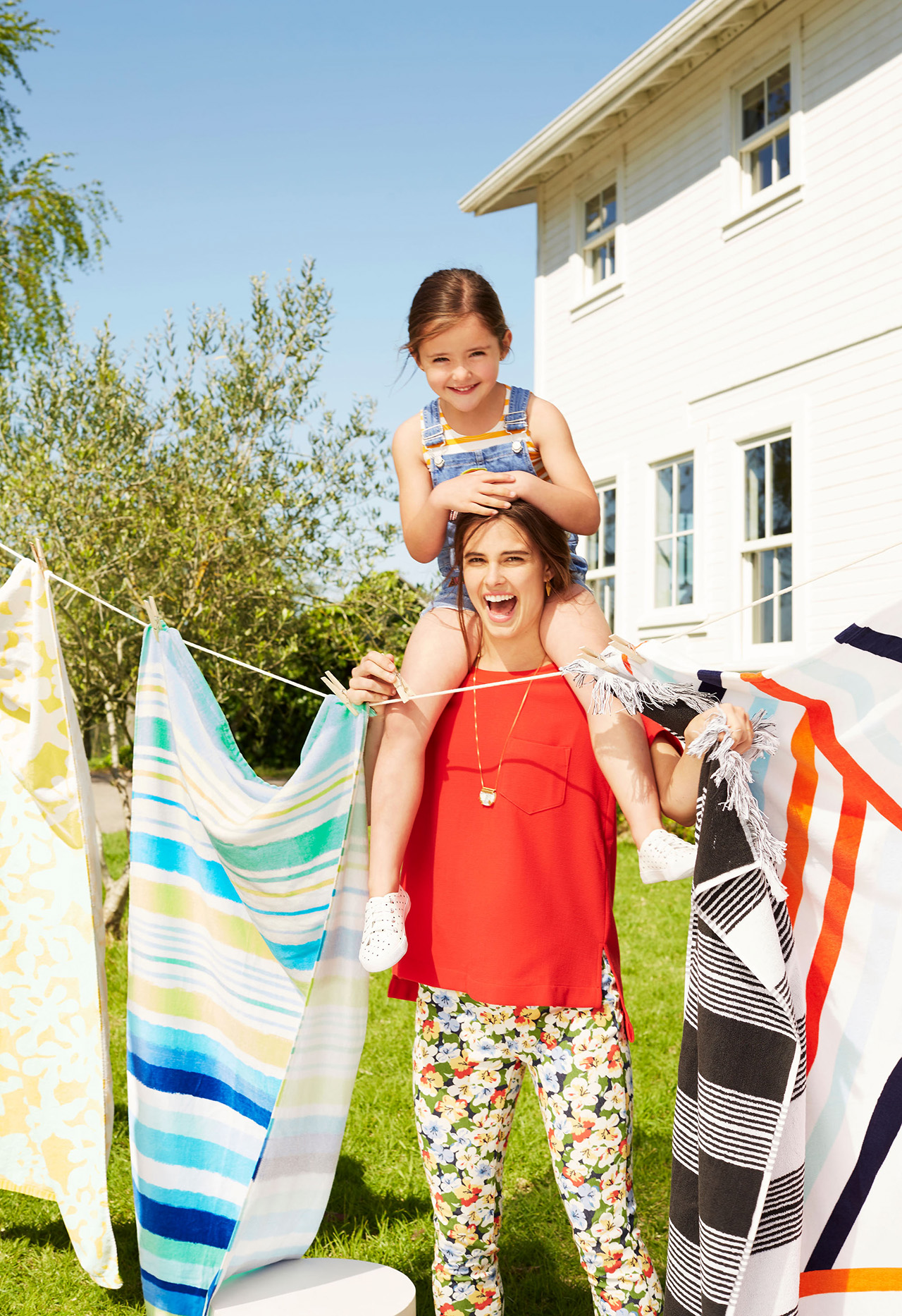 laundry chores with mom and daughter hanging clothing