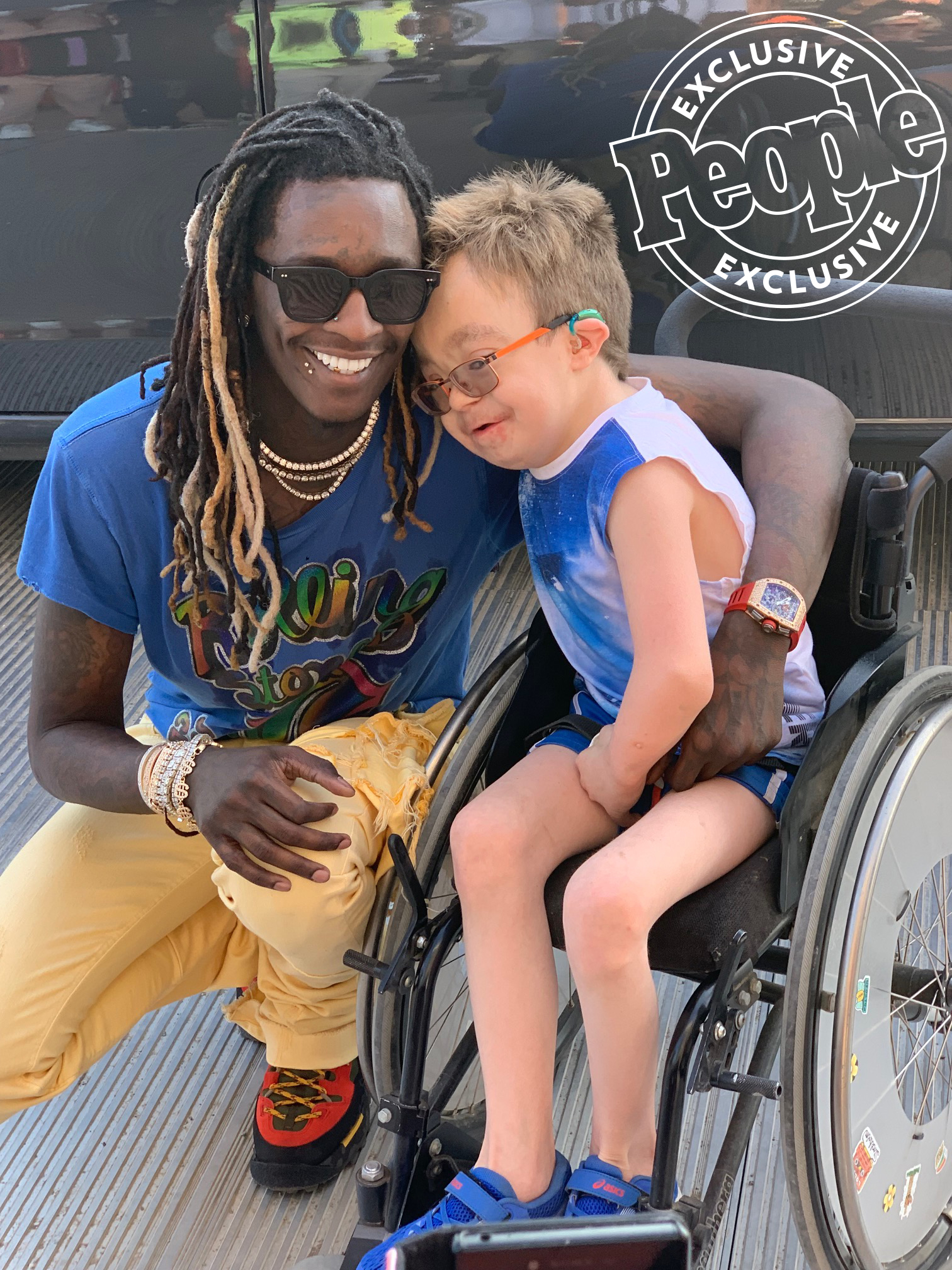 Young Thug and 14 year old fan Steven in Wheel Chair Hug 1