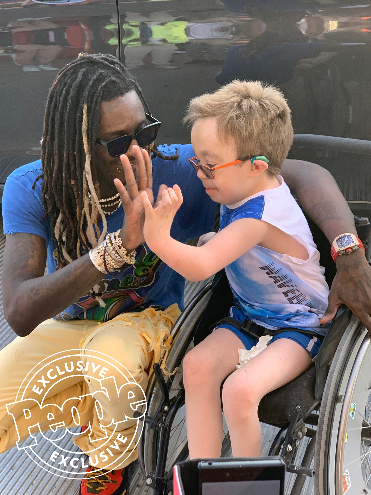 Young Thug and 14 year old fan Steven in Wheel Chair High Five