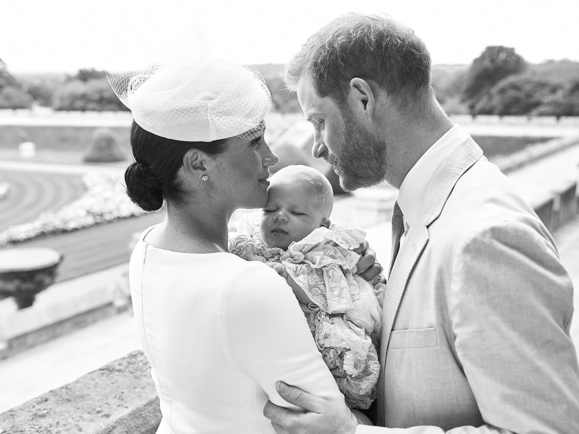 Black and White Photo of Meghan Markle Holding Baby Archie Harrison with Prince Harry