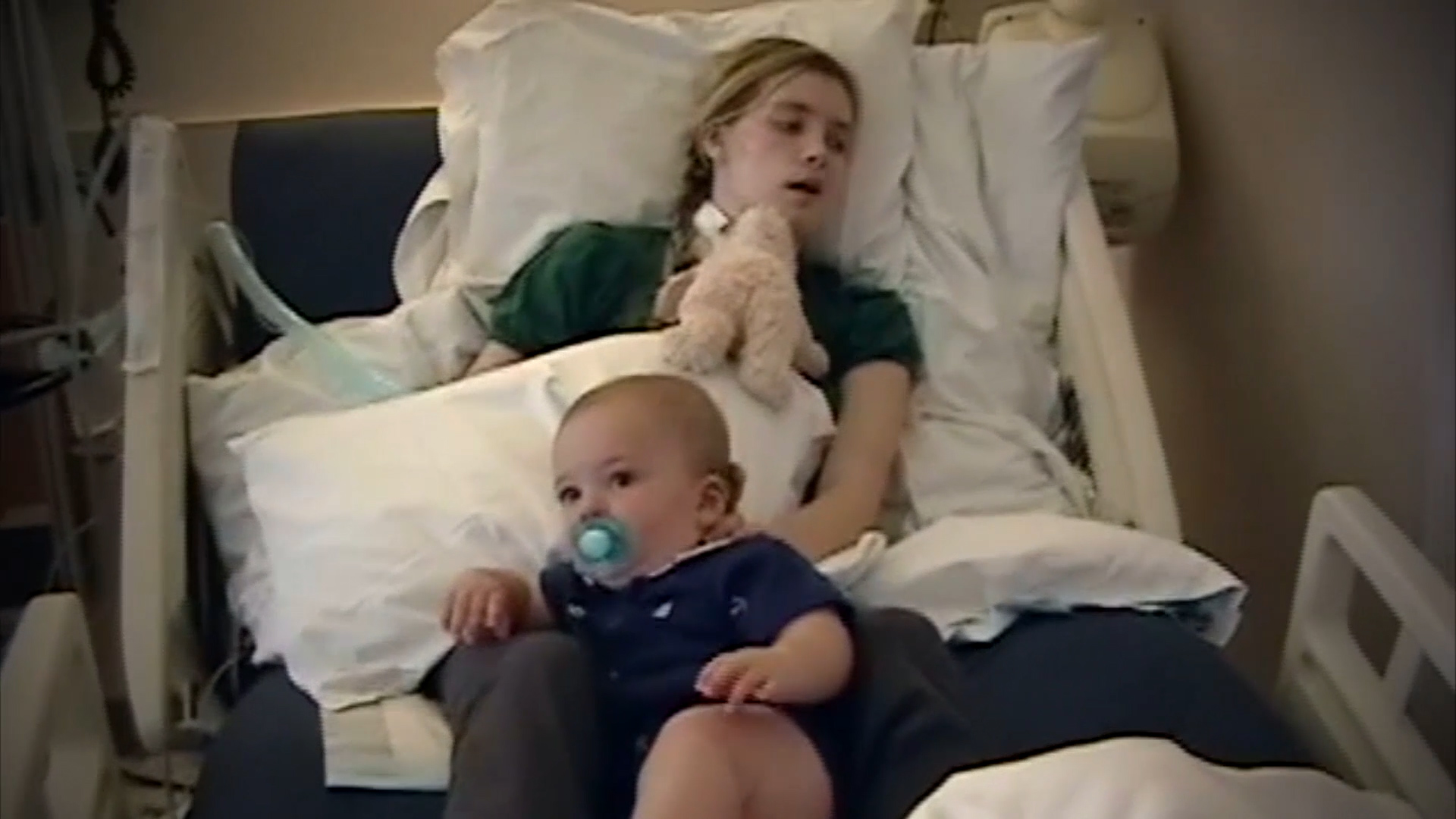 Parenting Against All Odds_Katherine and Jay Wolf - In Hospital Bed with Baby on Lap