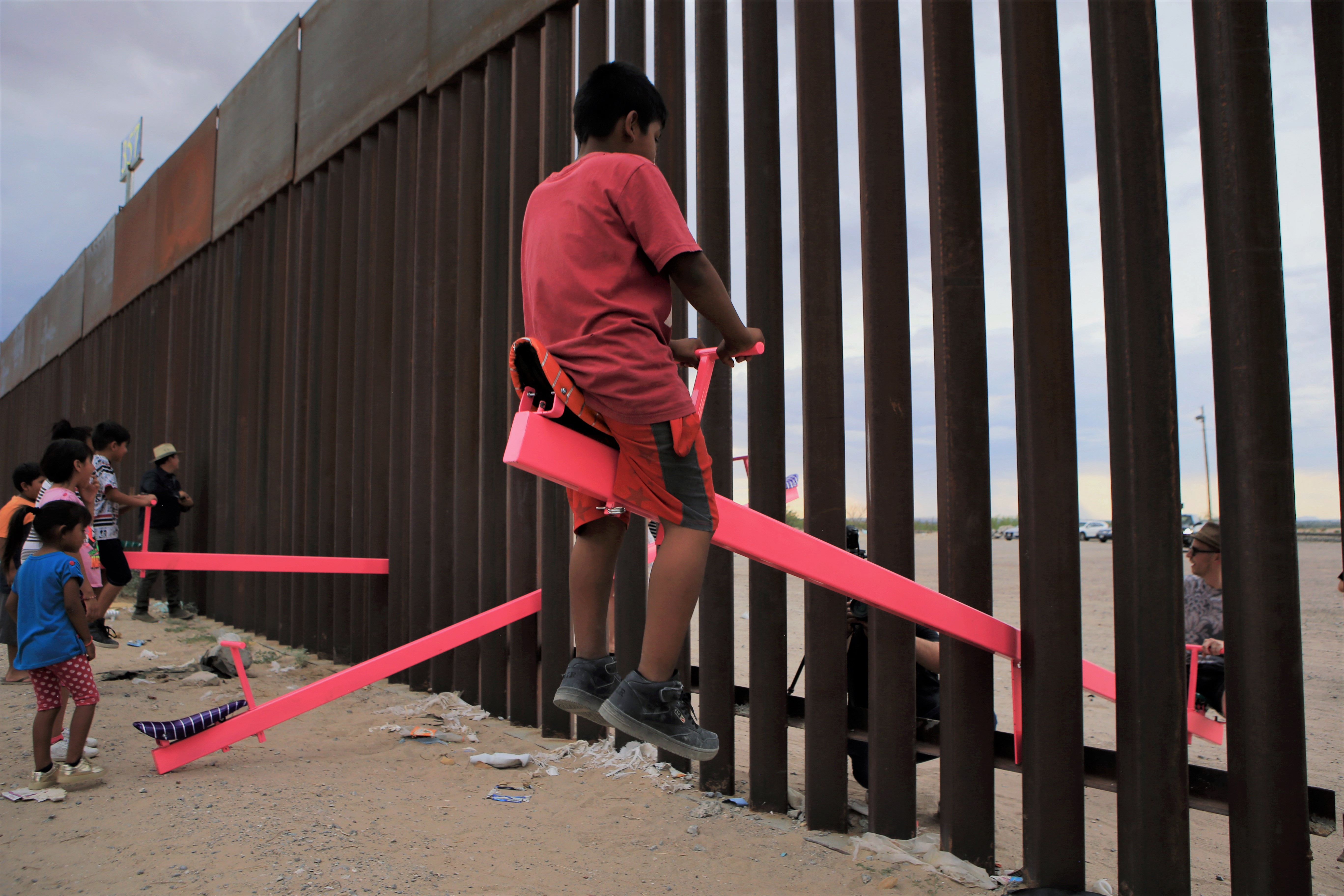 Mexico US Migrants Children on SeeSaw Swing over Mexican Boarder