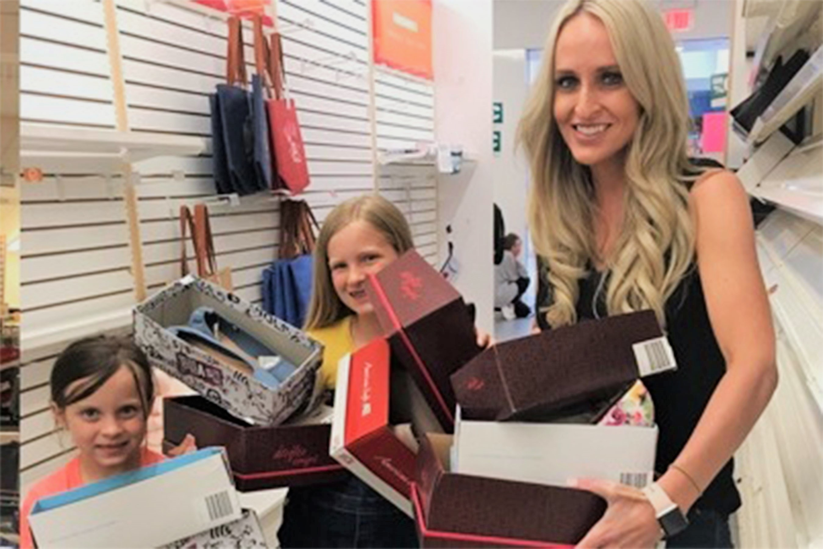 Carrie Jernigan and Children Holding Shoe Boxes at Payless