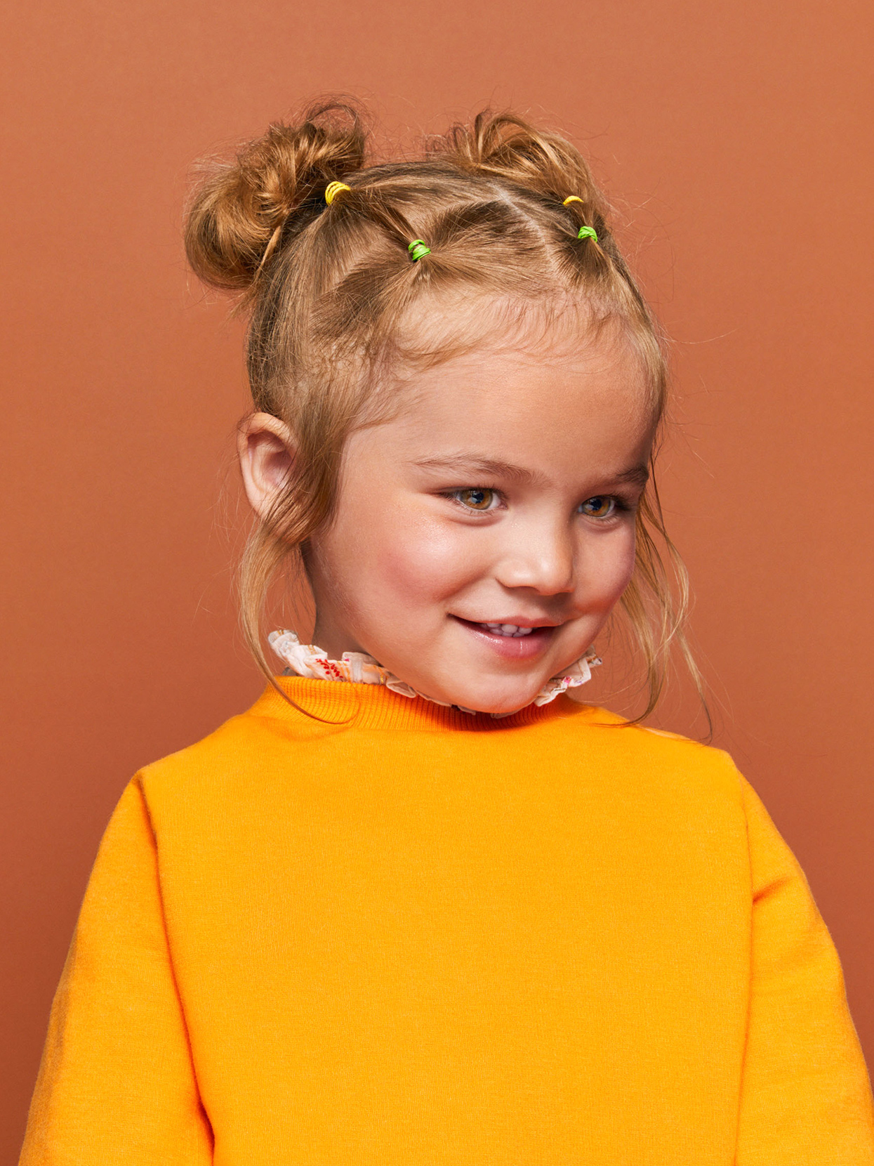 preschool-aged girl with rubber band hairstyle