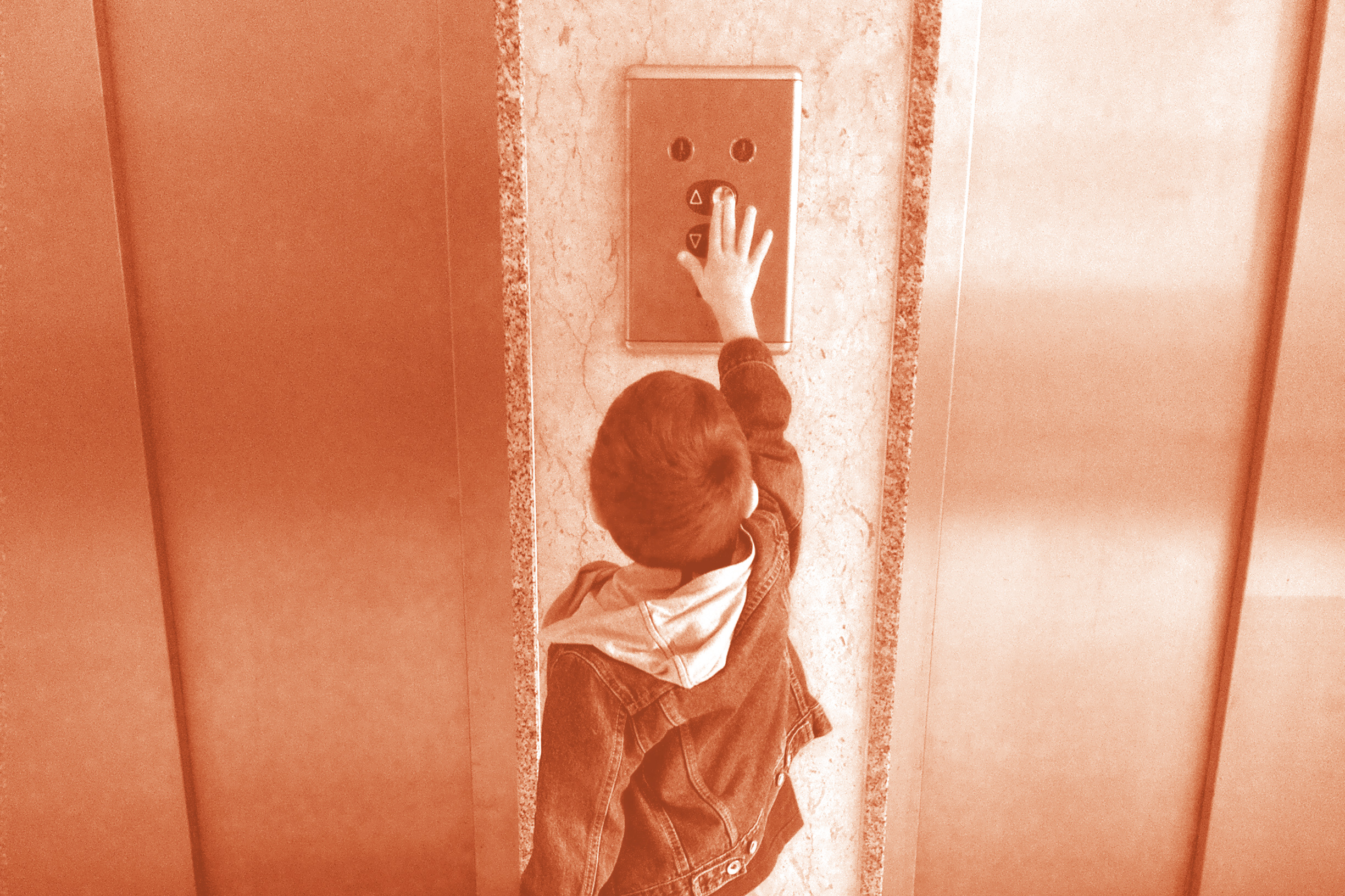 little boy pushing elevator button