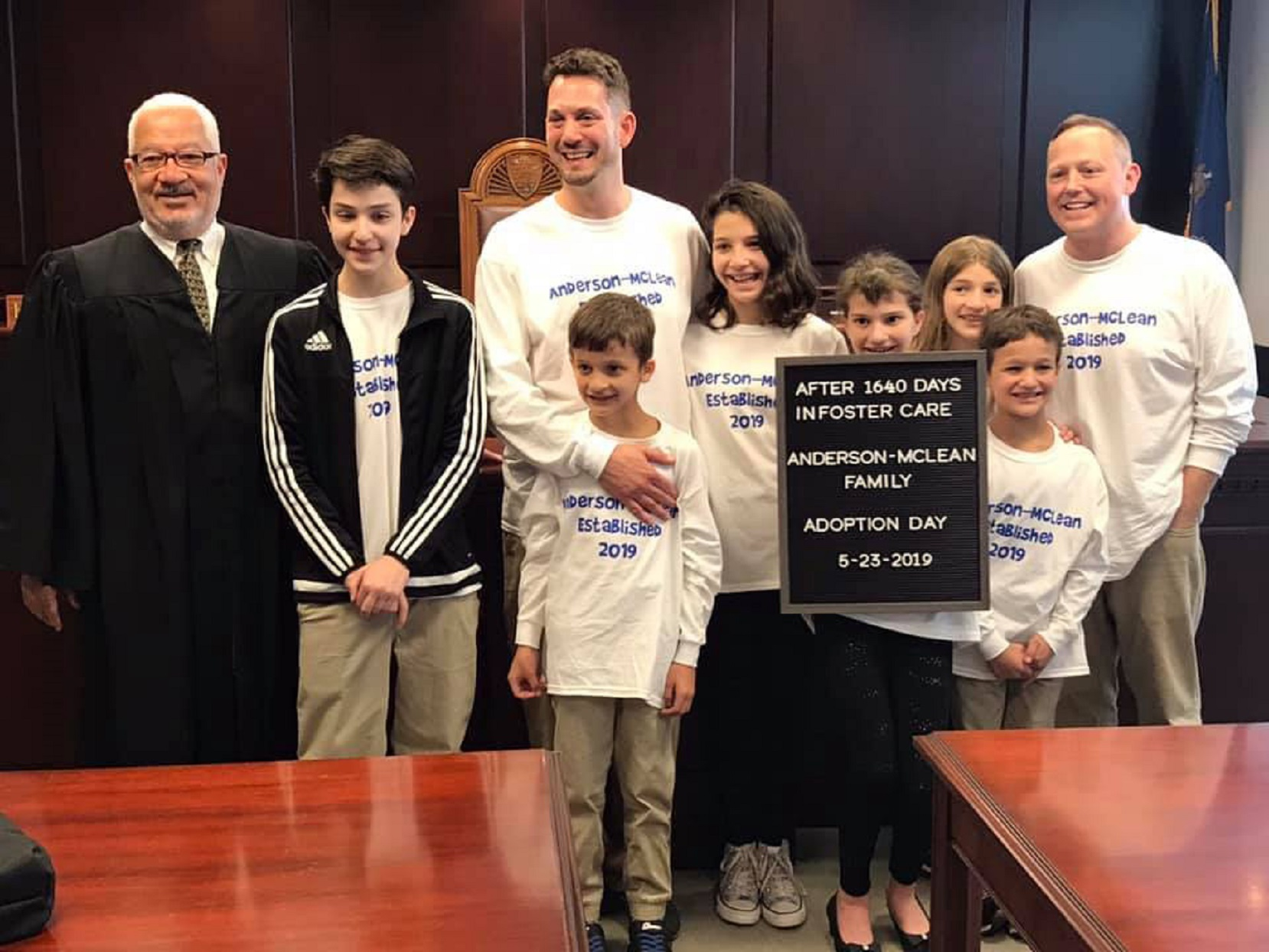 Steve Anderson-McLean and Rob Anderson-McLean with adoptive children on adoption day