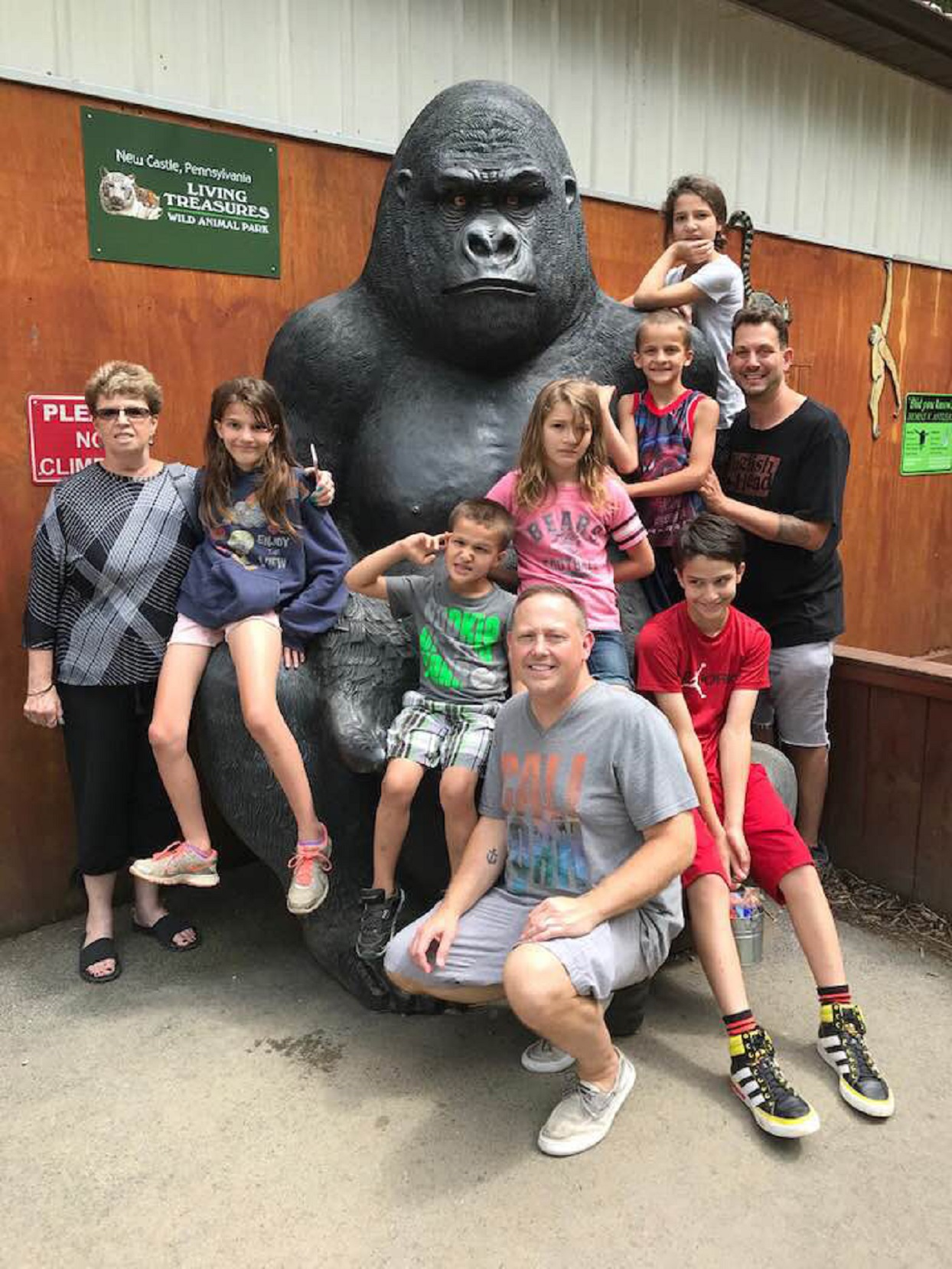 Steve Anderson-McLean and Rob Anderson-McLean and family with gorilla statue