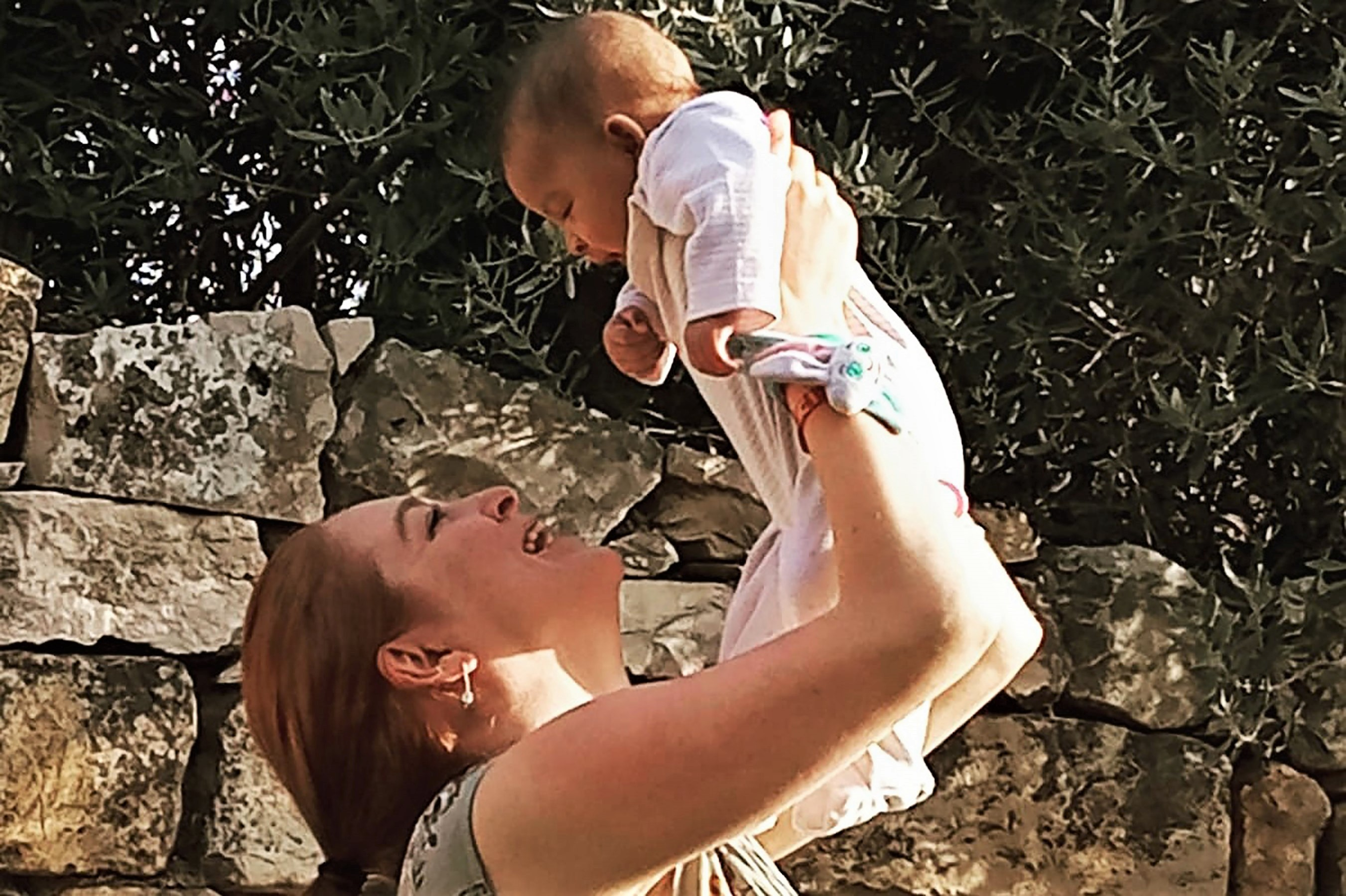 Game of Thrones Actress Josephine Gillan Holding Up Baby