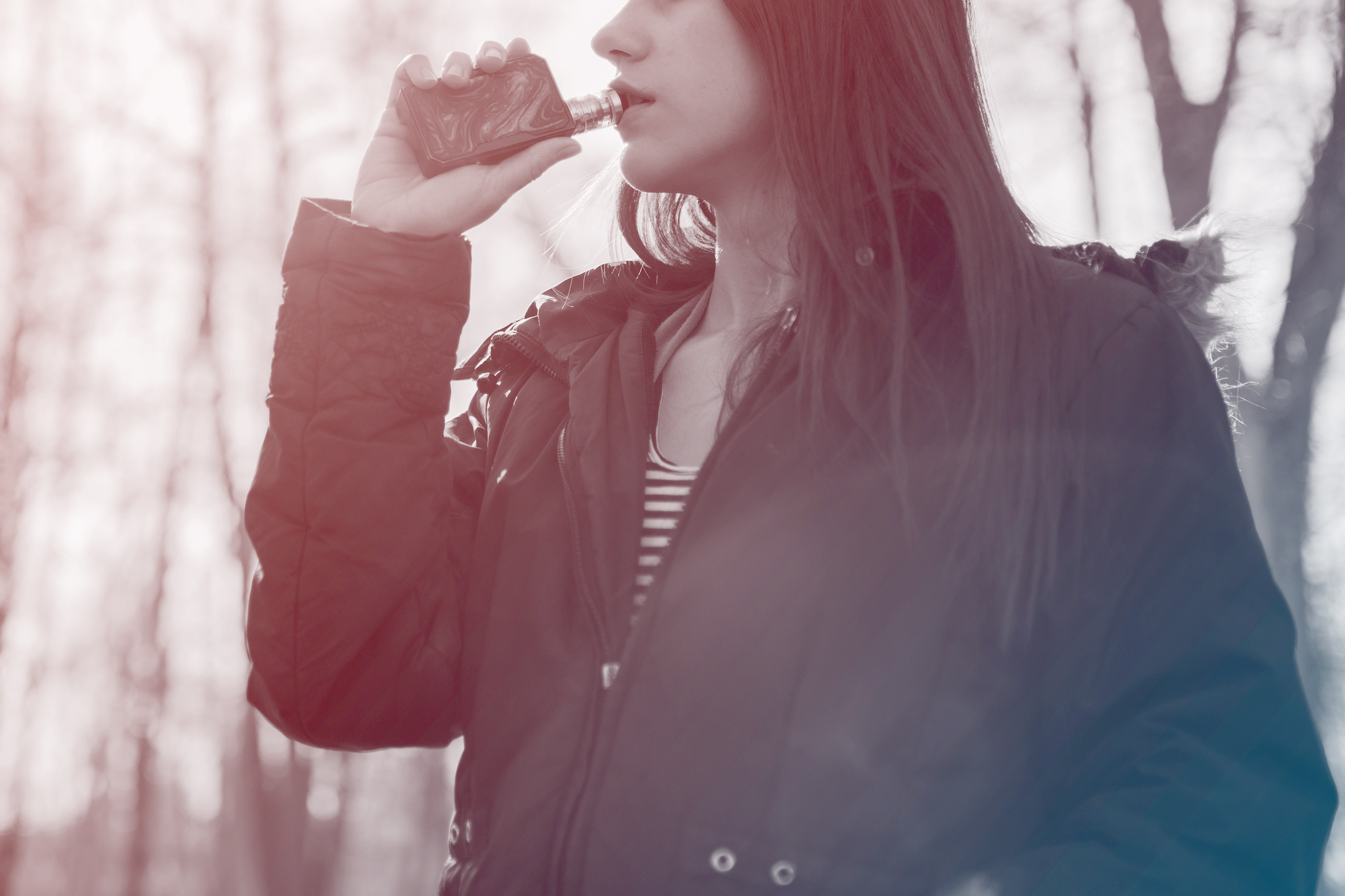 woman vaping in the woods